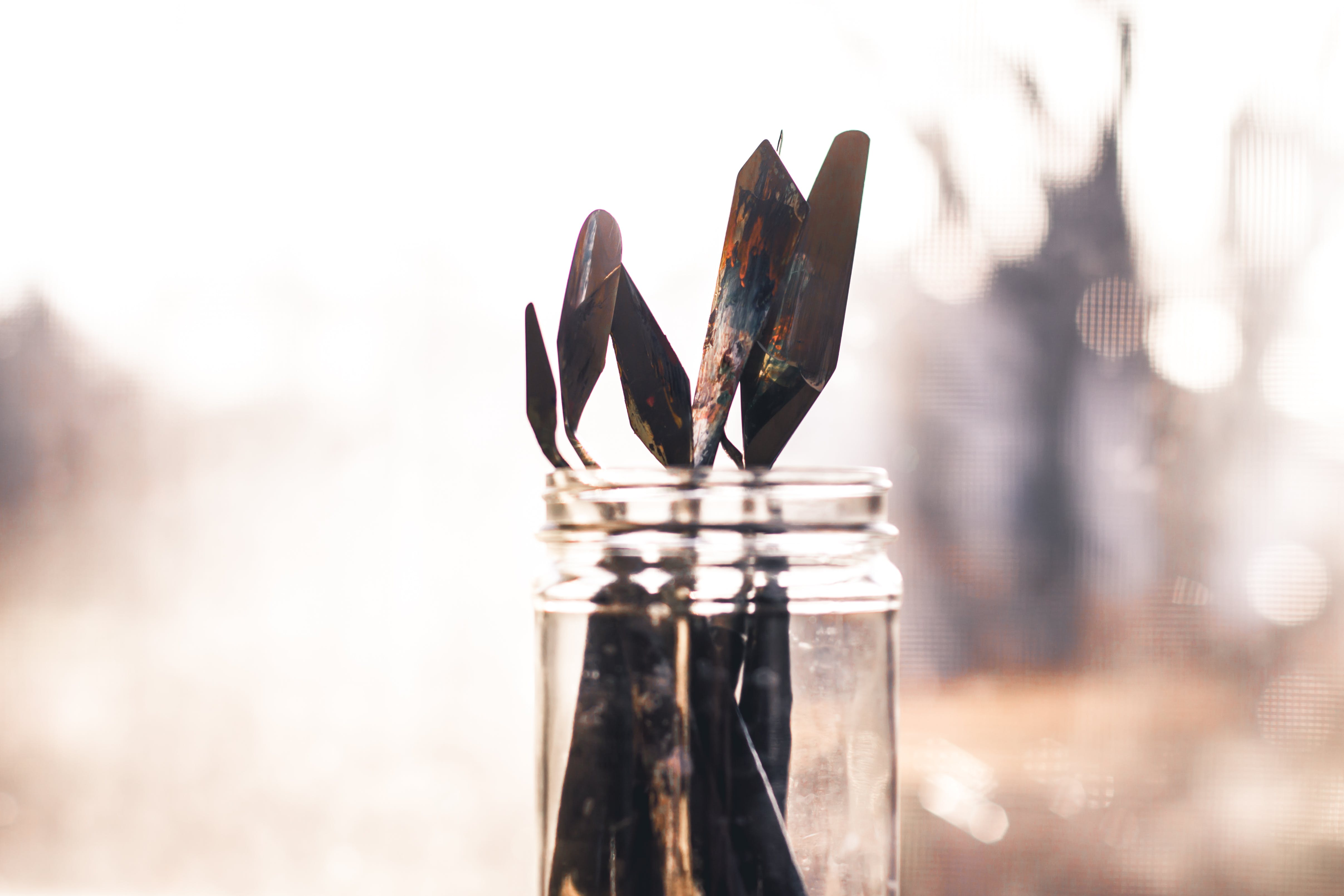 Shallow Focus Photography of Clear Glass Jar