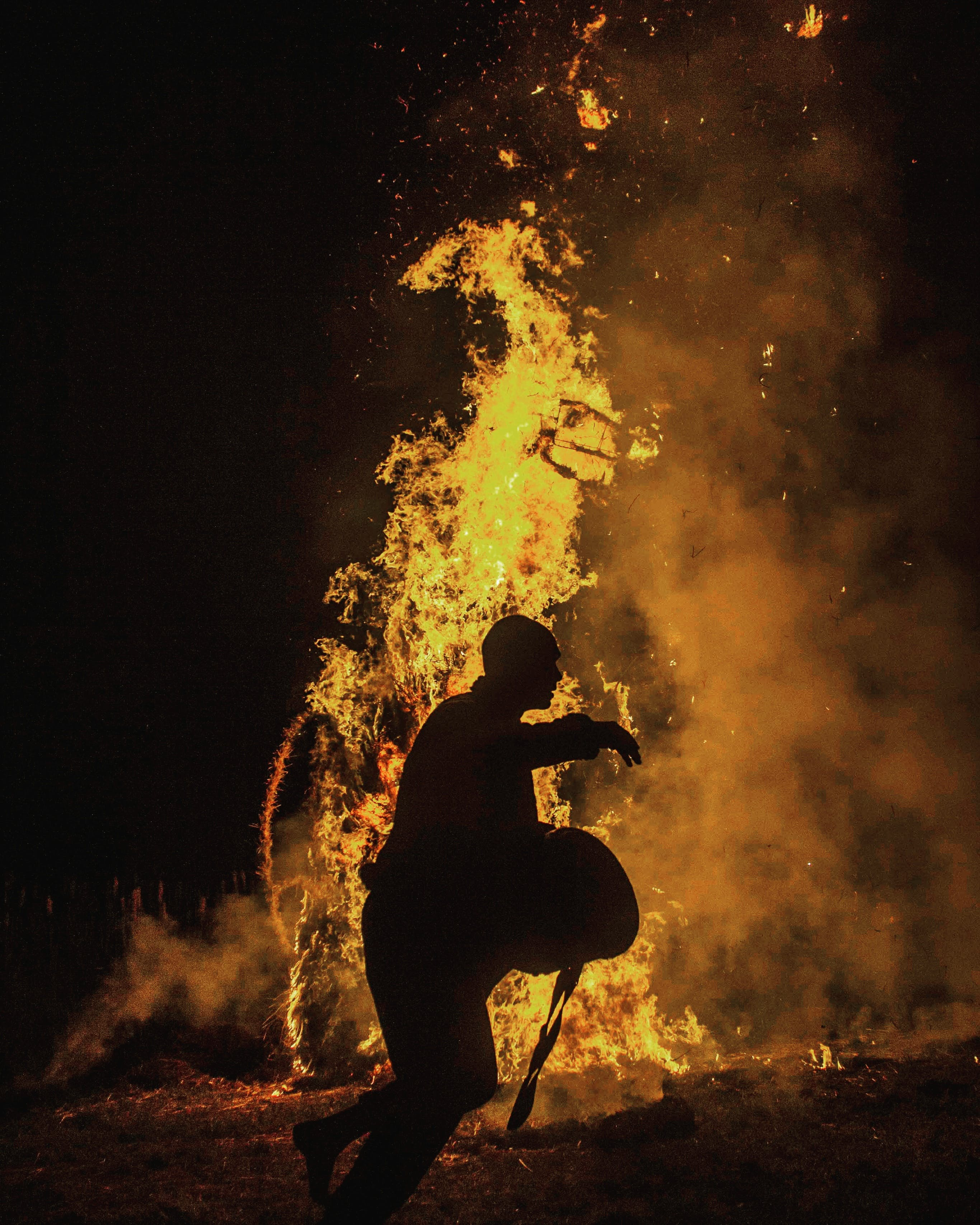 Person Silhouette Near the Fire
