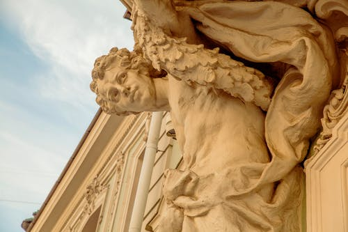 Closeup Photo of Statue of Man