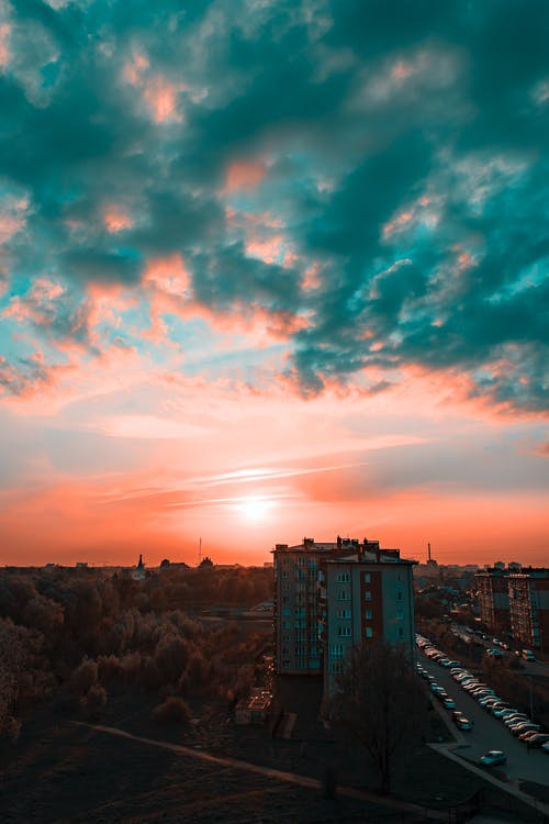 Photography of Grey Buildings during Sunset