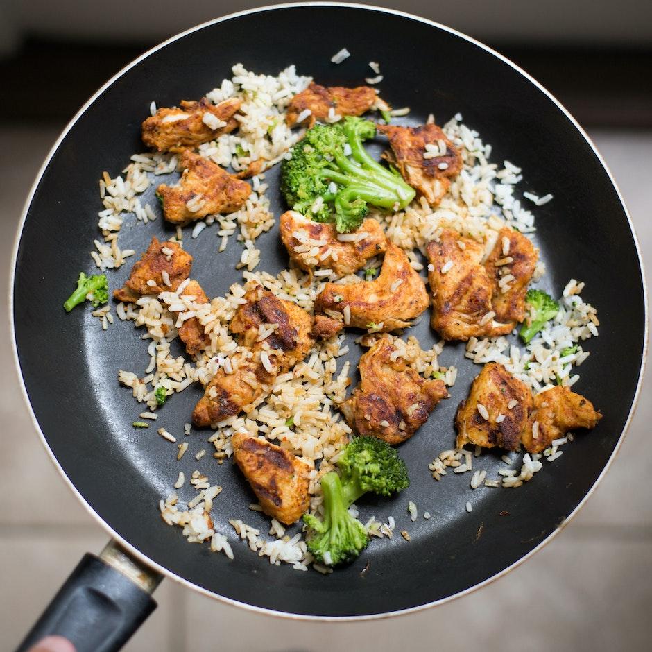 White Rice, Chicken and Broccoli on Black Non-stick Pan