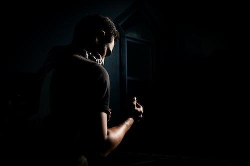 Man in Black Top Standing