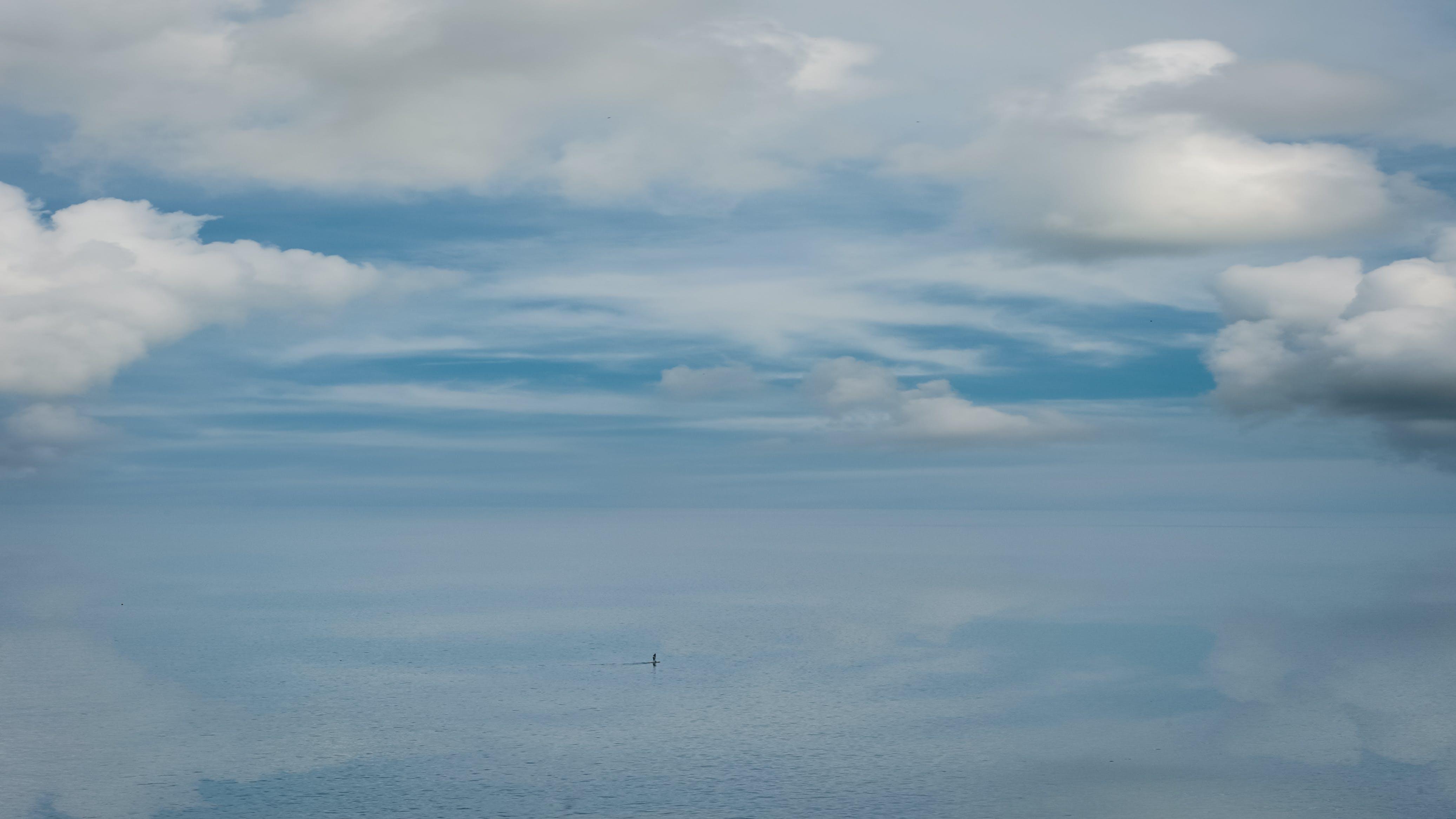 Scenic View of Ocean Under Cloudy Sky
