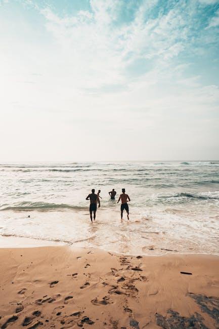 People running near seashore at daytime photo