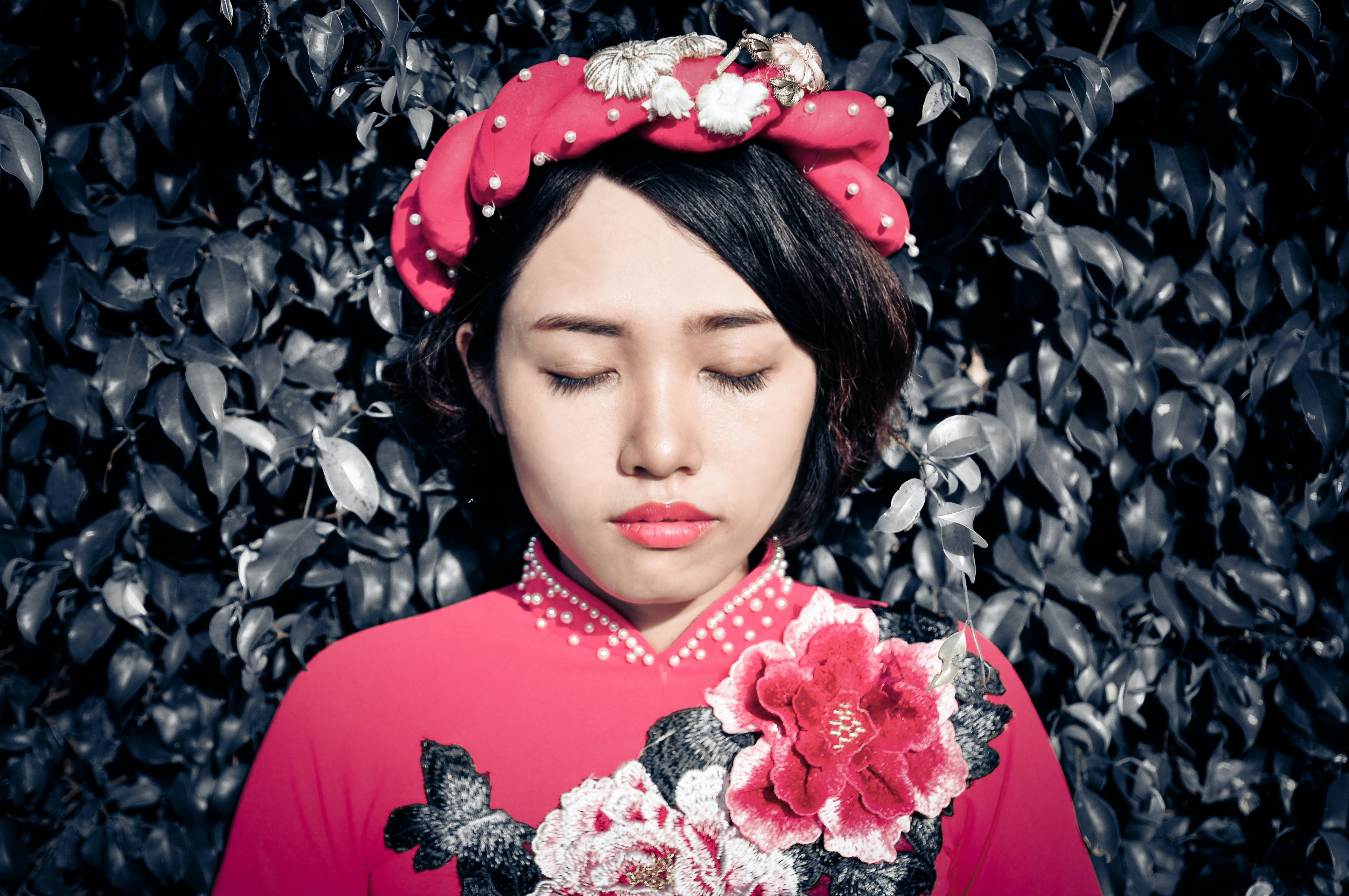 Woman With Her Eyes Closed Wearing Pink Floral Top