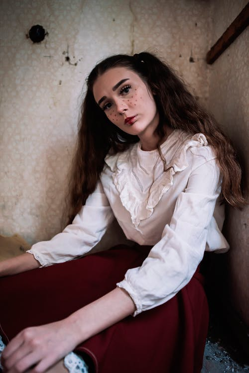 Brown Haired Woman Wearing White Long-sleeved Shirt and Red Skirt