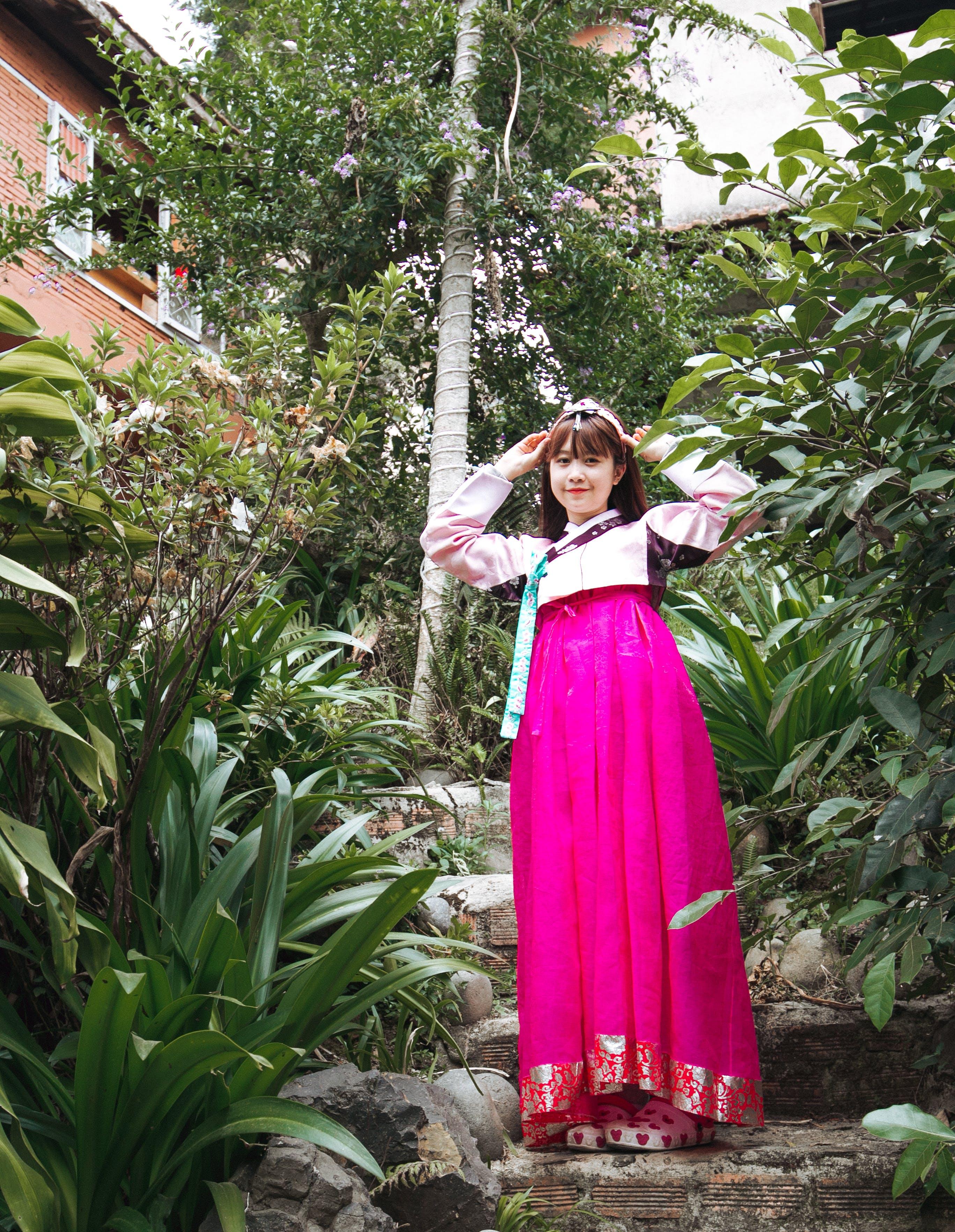 Woman Wearing Pink Long-sleeved Dress