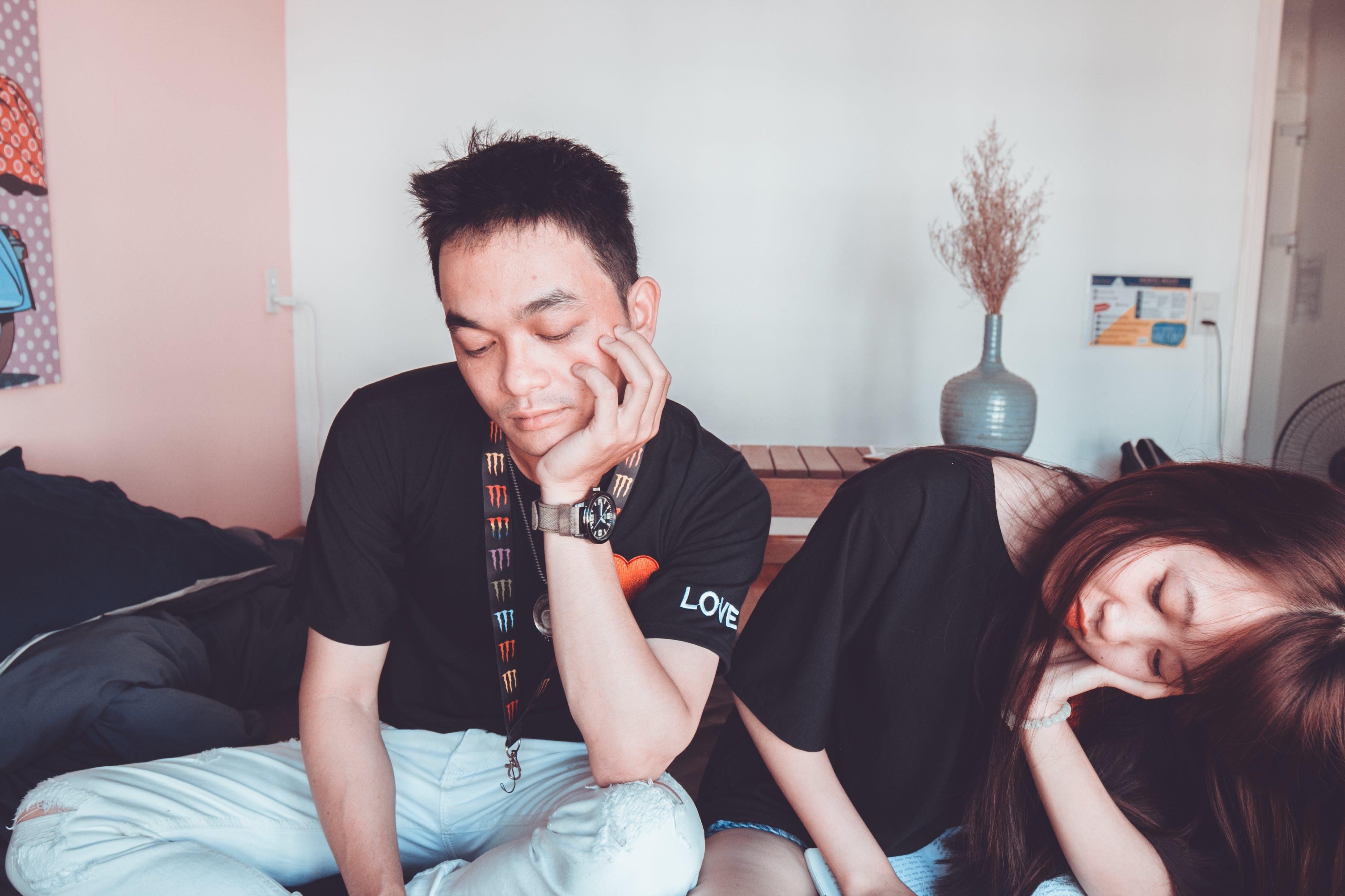 Man Wearing Black Crew-neck Shirt Beside a Woman