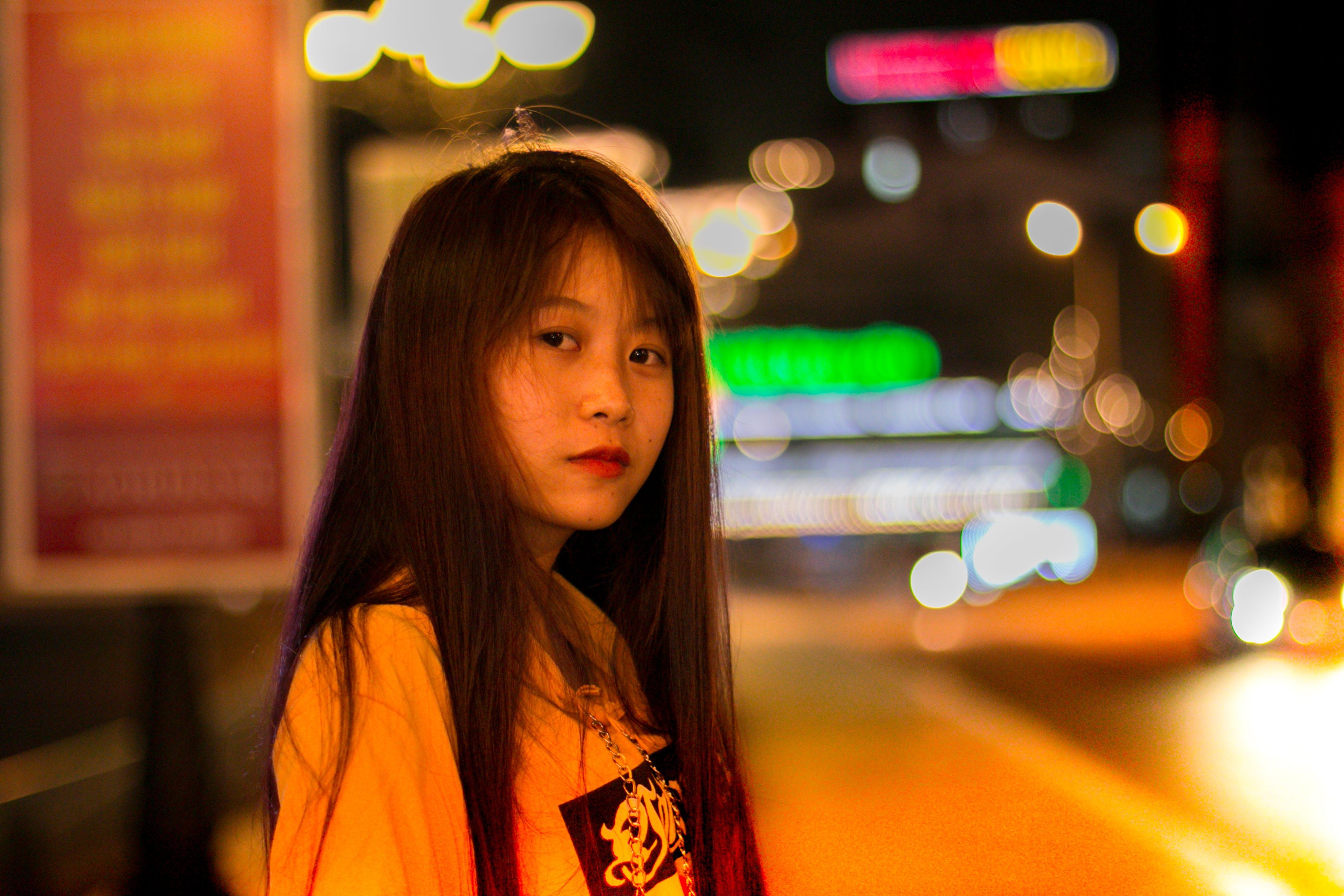 Selective Focus Photo of Woman Wearing Yellow Shirt