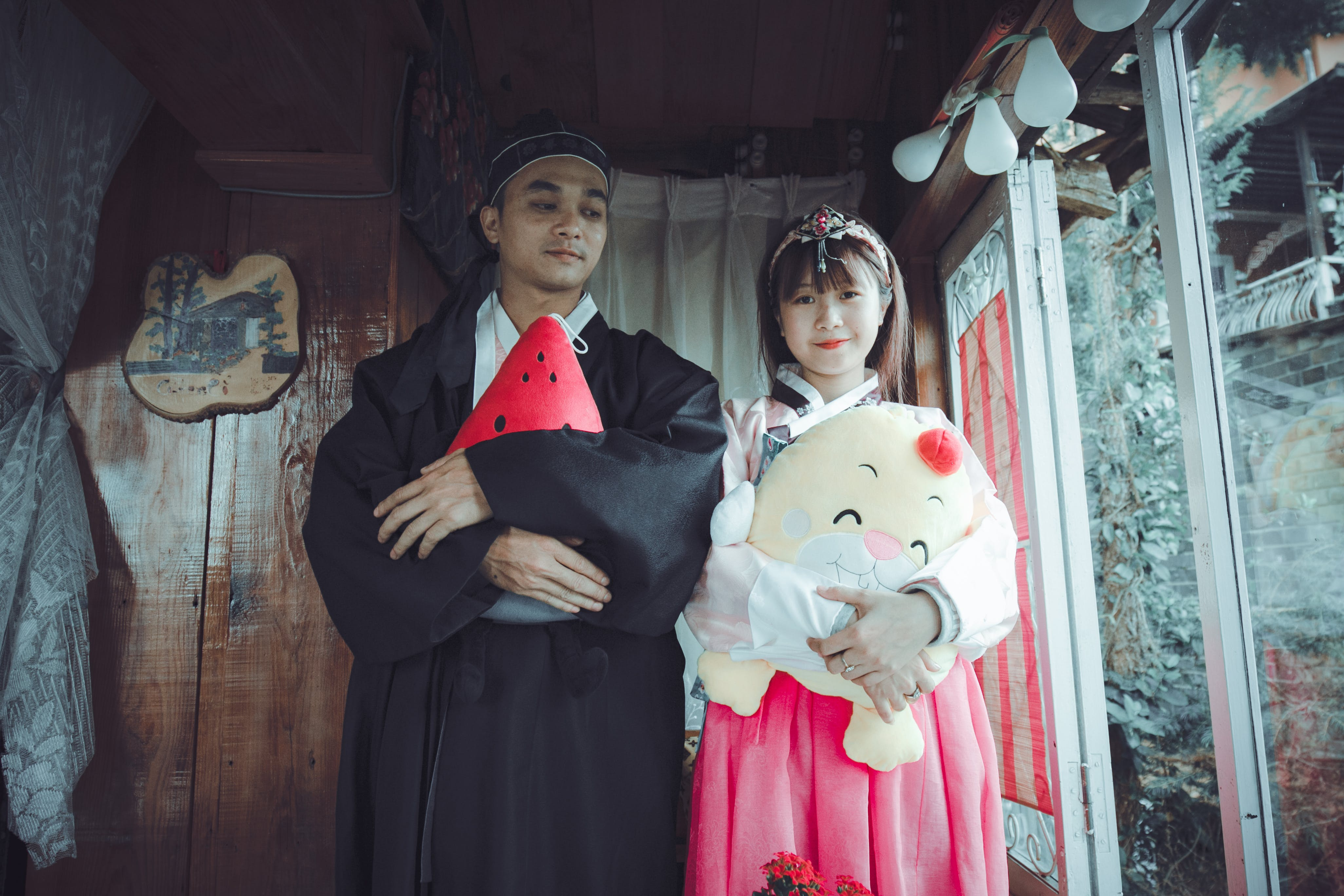 Man and Woman Wearing Traditional Dresses
