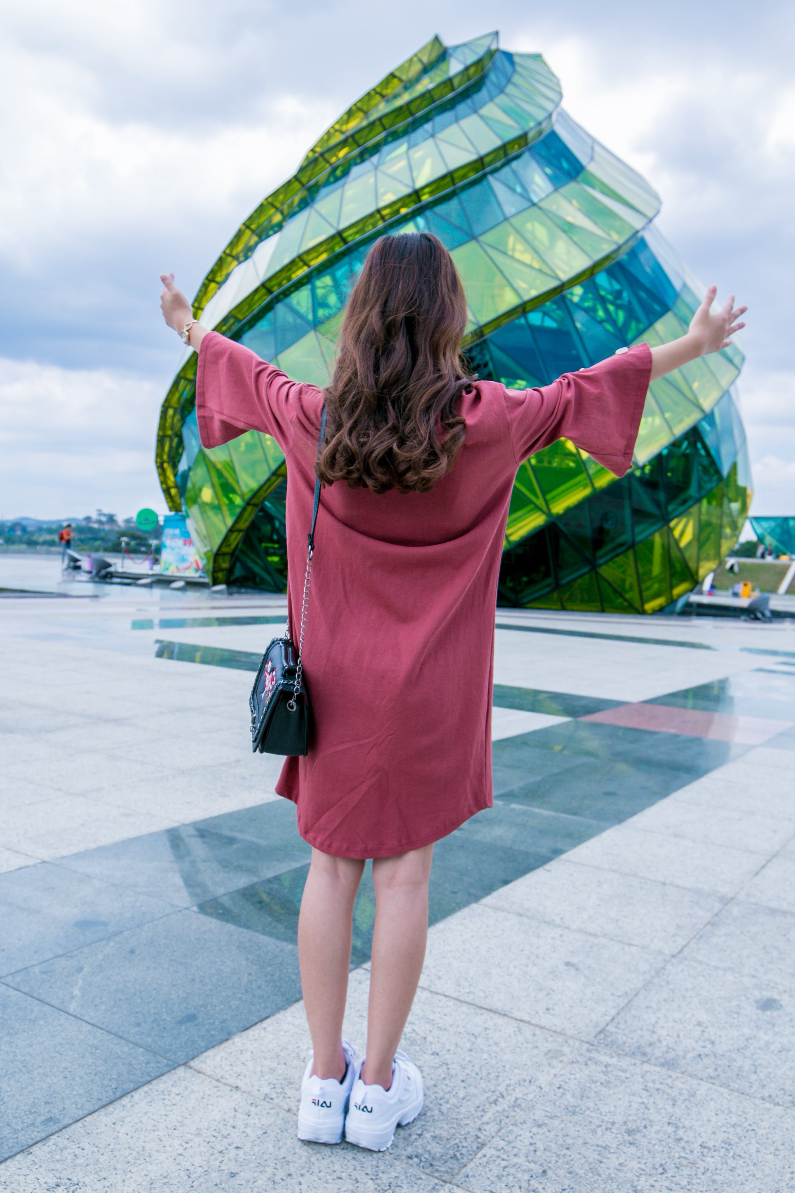 Woman Standing In-front of Glass Building
