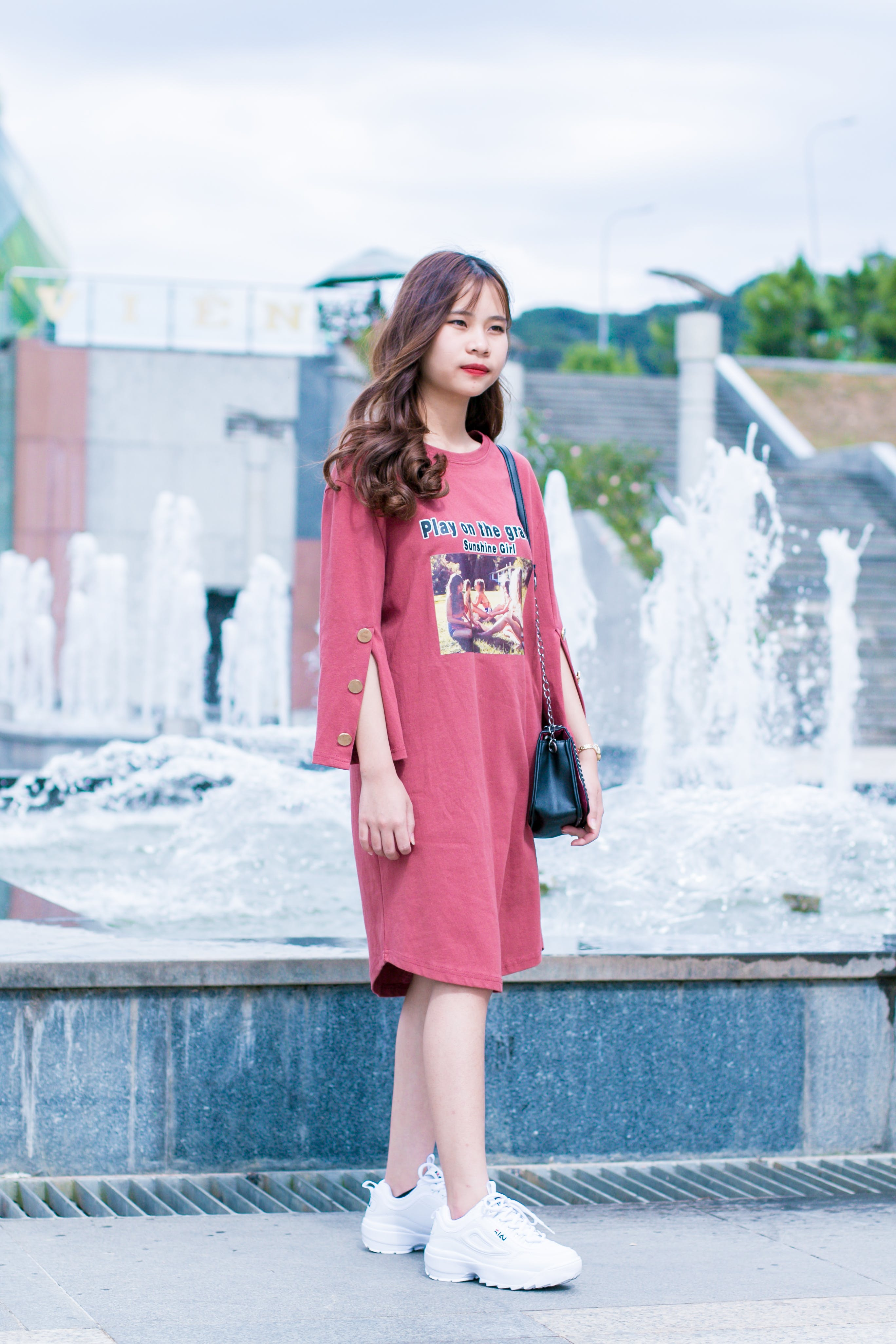 Woman Wearing Pink Dress Standing Near Water Fountain