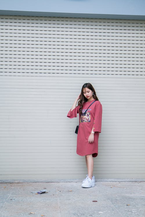 Woman in Pink Long-sleeved Midi-dress and Pair of White Shoes