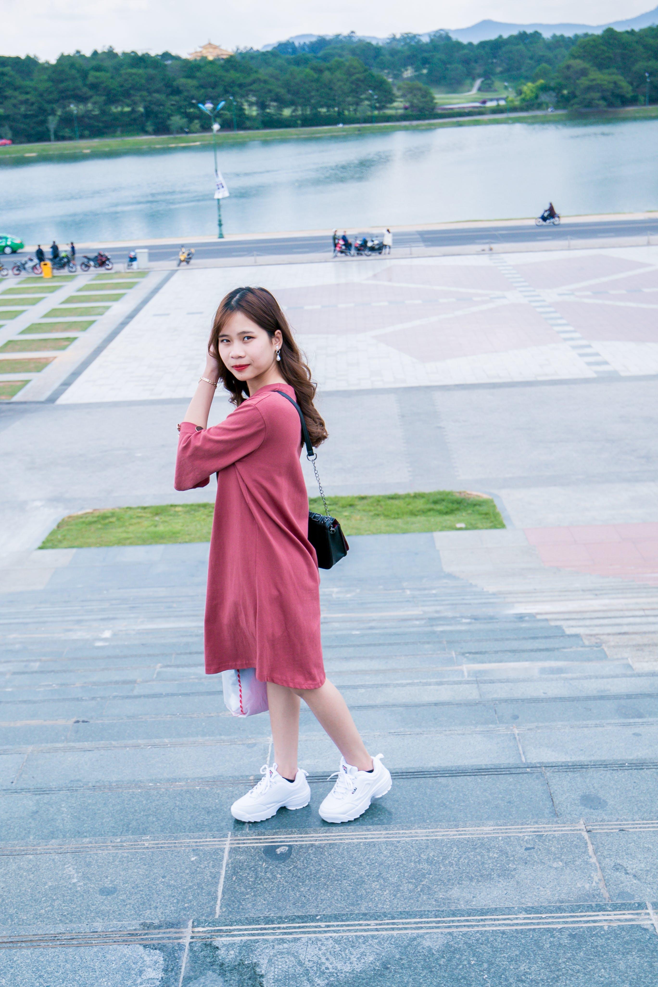 Woman Wearing Pink 3/4-sleeved Midi Dress