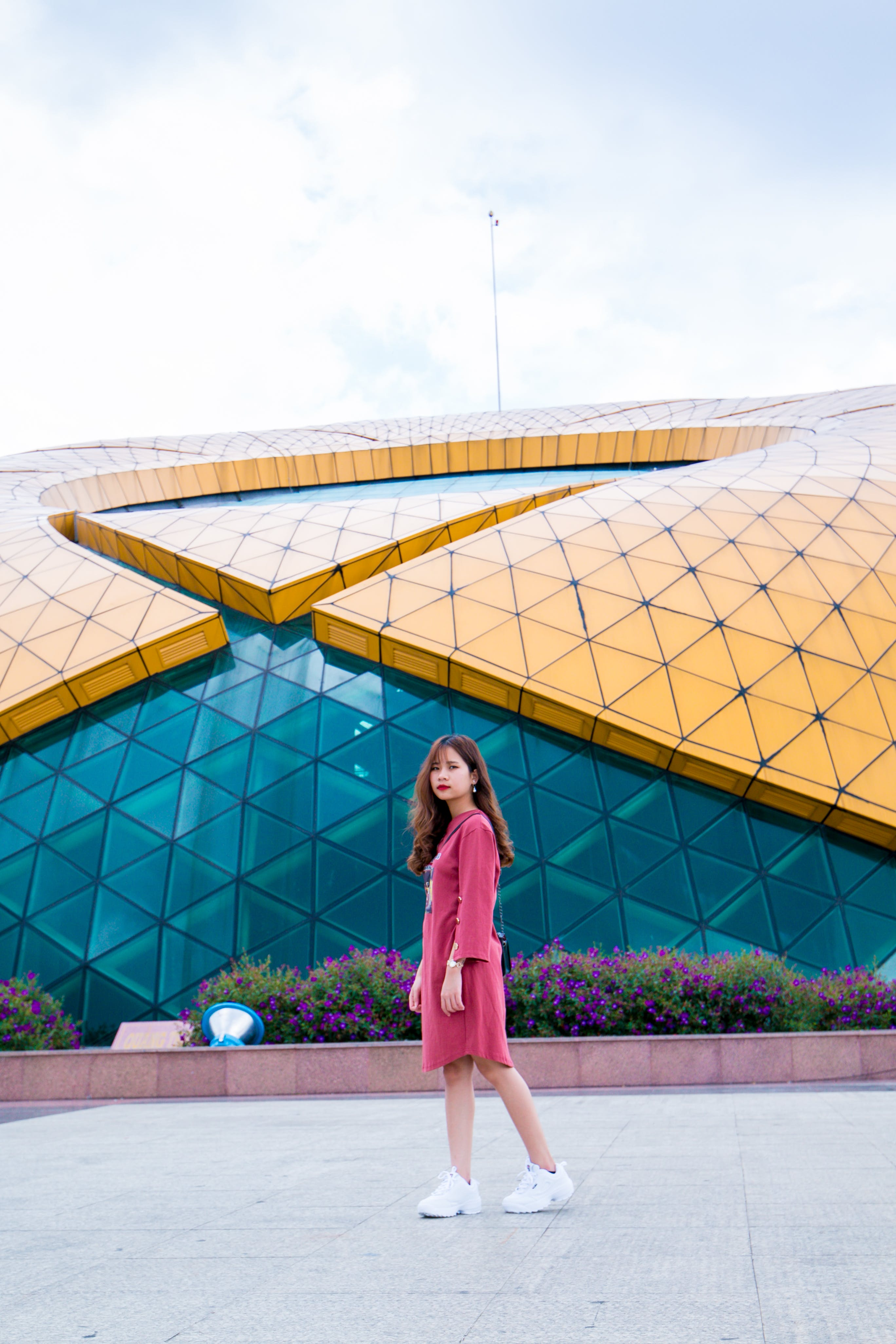 Woman Wearing Pink Dress Standing Near Building at Daytime