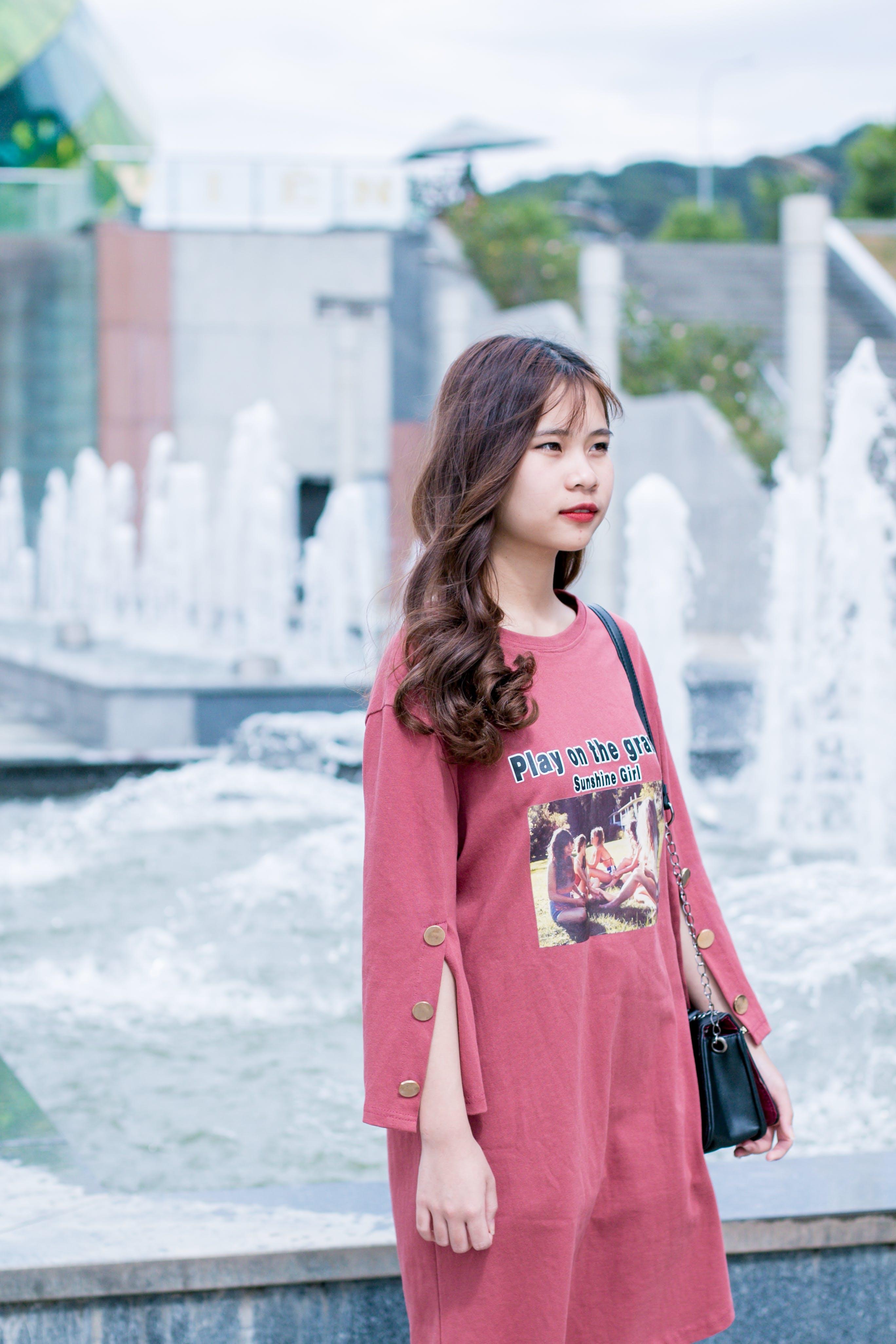 Woman Wearing Red Dress Near Fountain