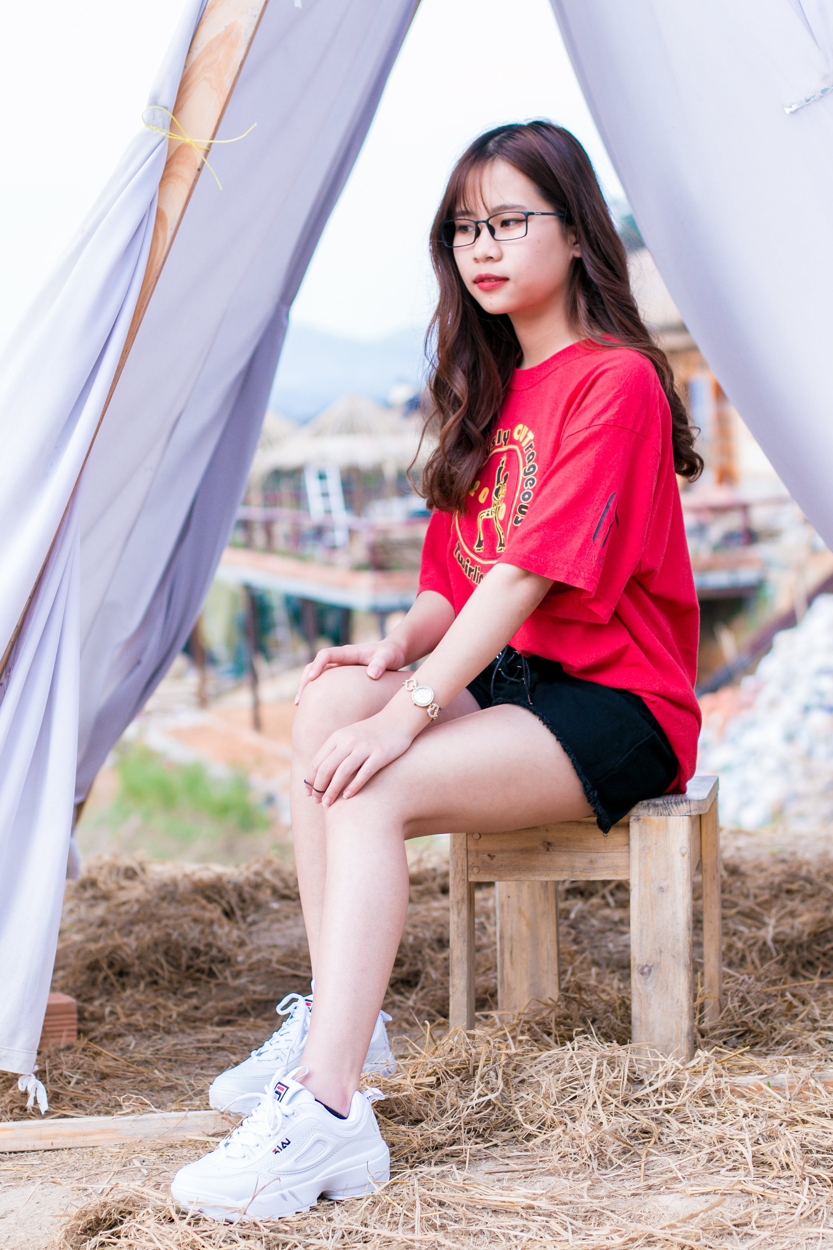 Woman in Red T-shirt and Black Denim Shorts