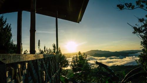 Free stock photo of clouds, dawn, mountain, nipa hut