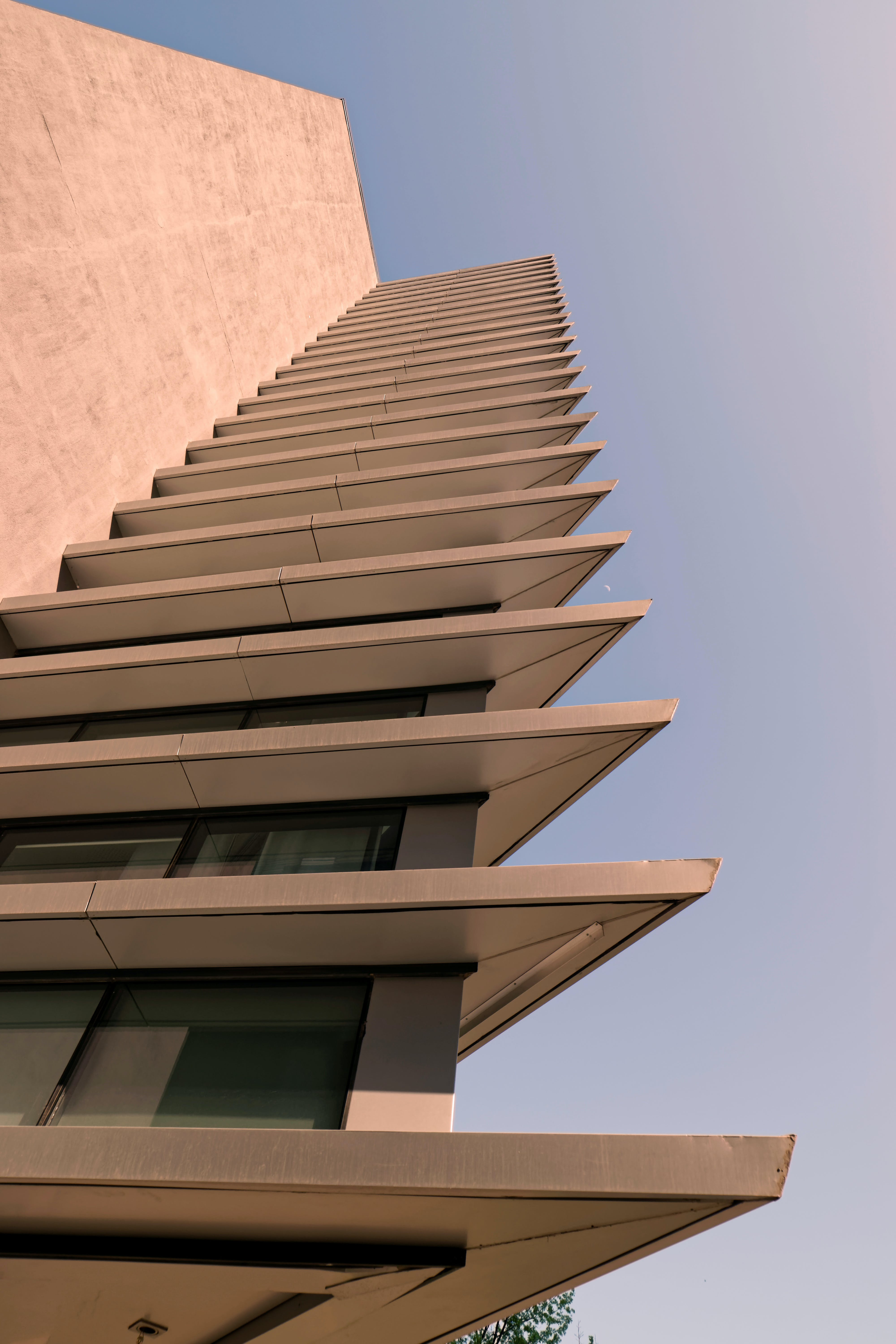 Low Angle Photo of Beige High Rise Building