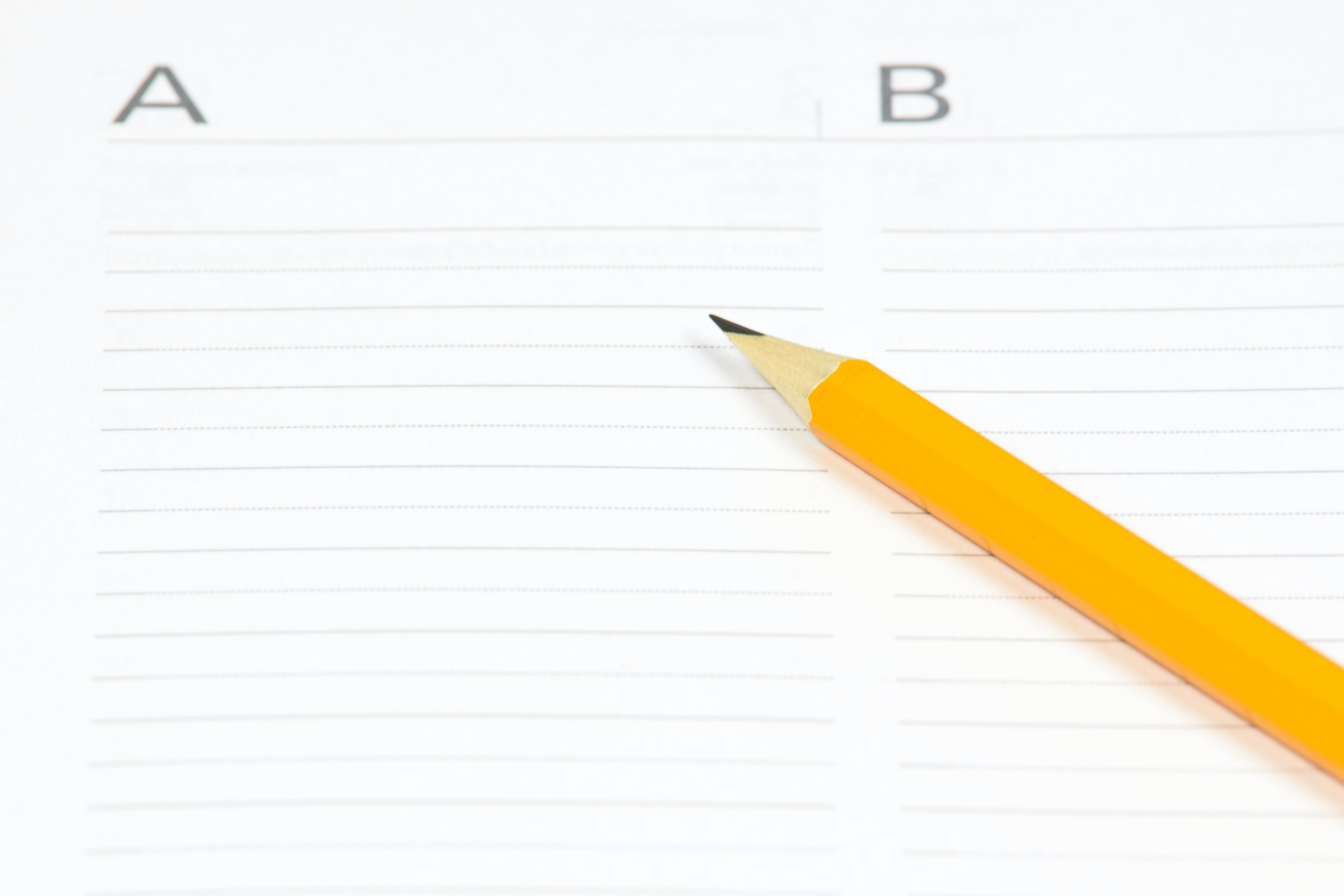 Yellow Pencil on White Ruled Paper