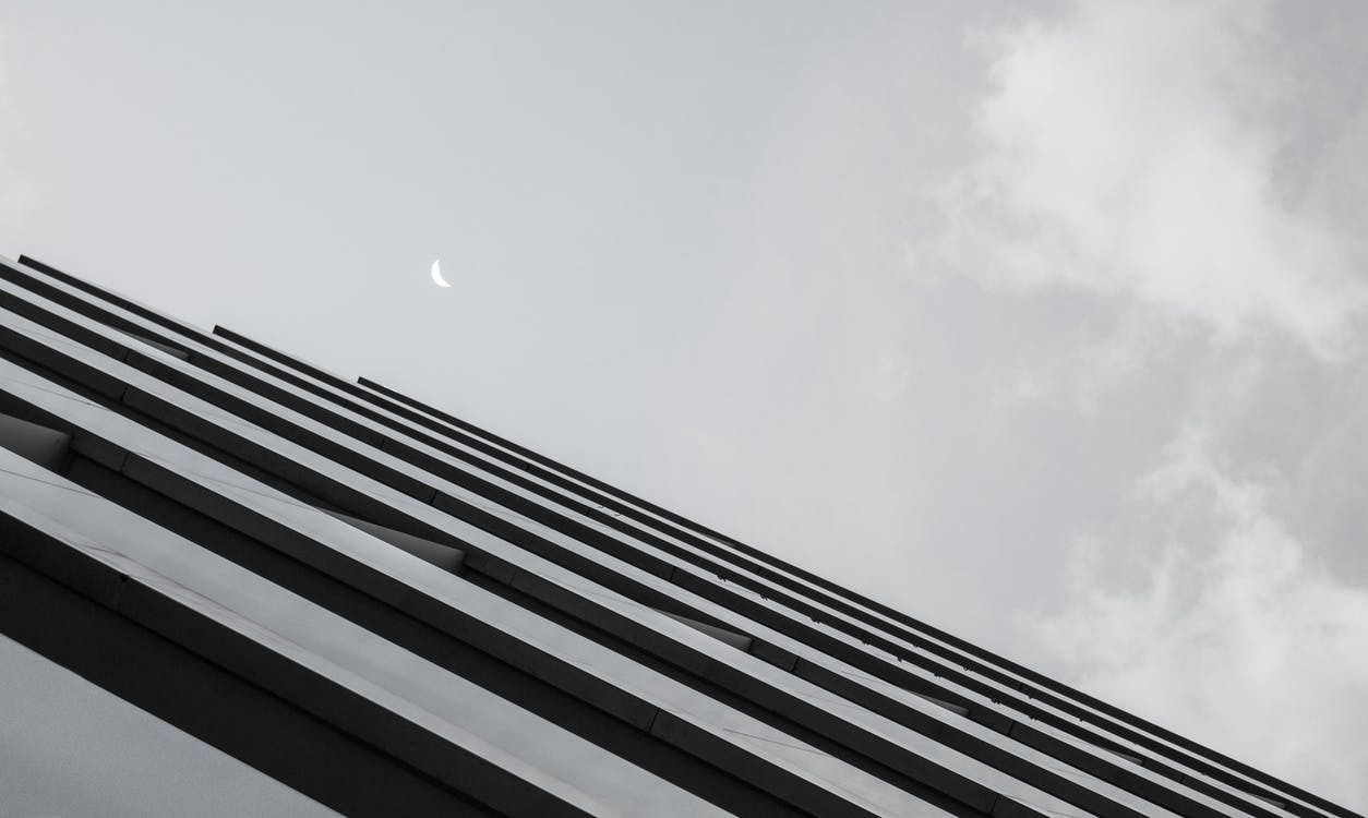 Grayscale Photo of Gray Concrete Building