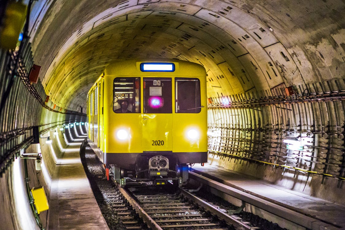 Yellow and Black Train Under Tunnel