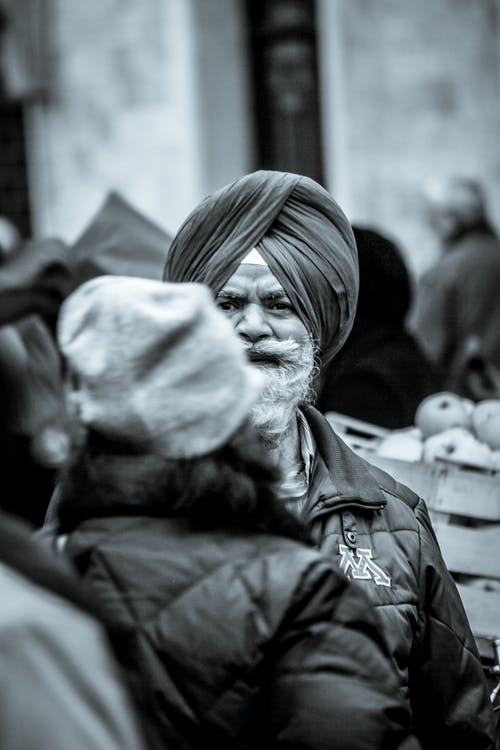 Photography of Man Wearing Zip-up Bubble Jacket and Turban