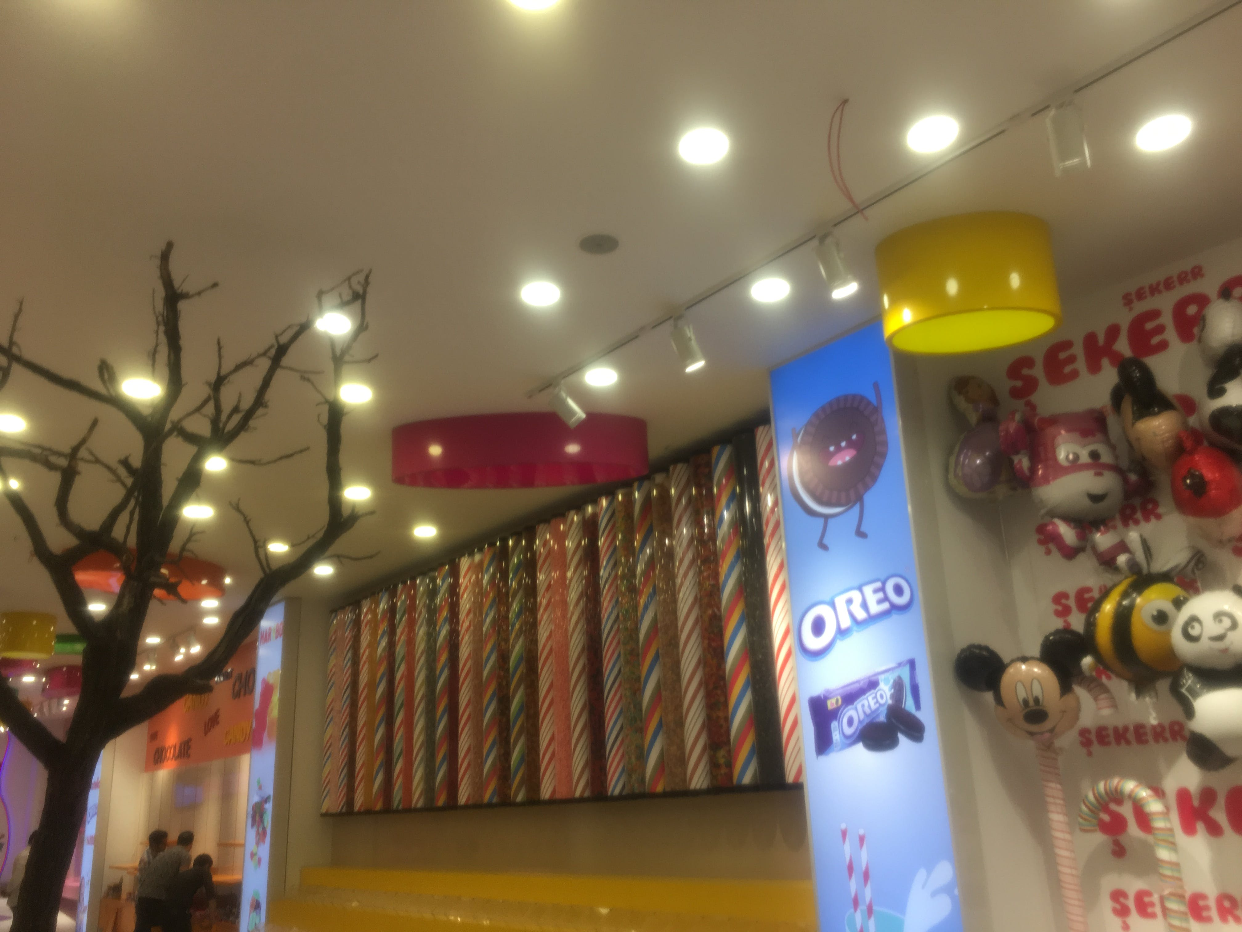Mickey Mouse Balloon Beside Oreo Poster
