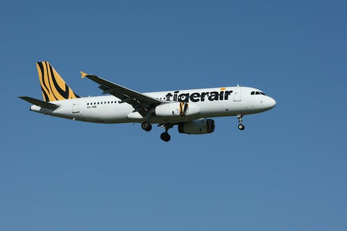 White and Yellow Tigerair Airplane