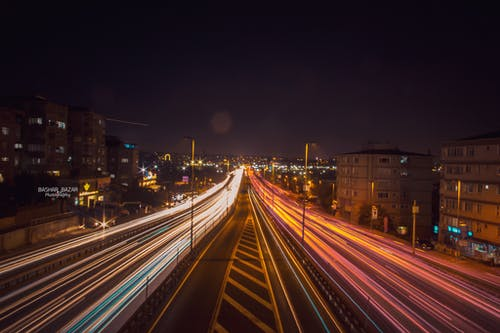 Time Lapse Photography of Road Beside Buildings