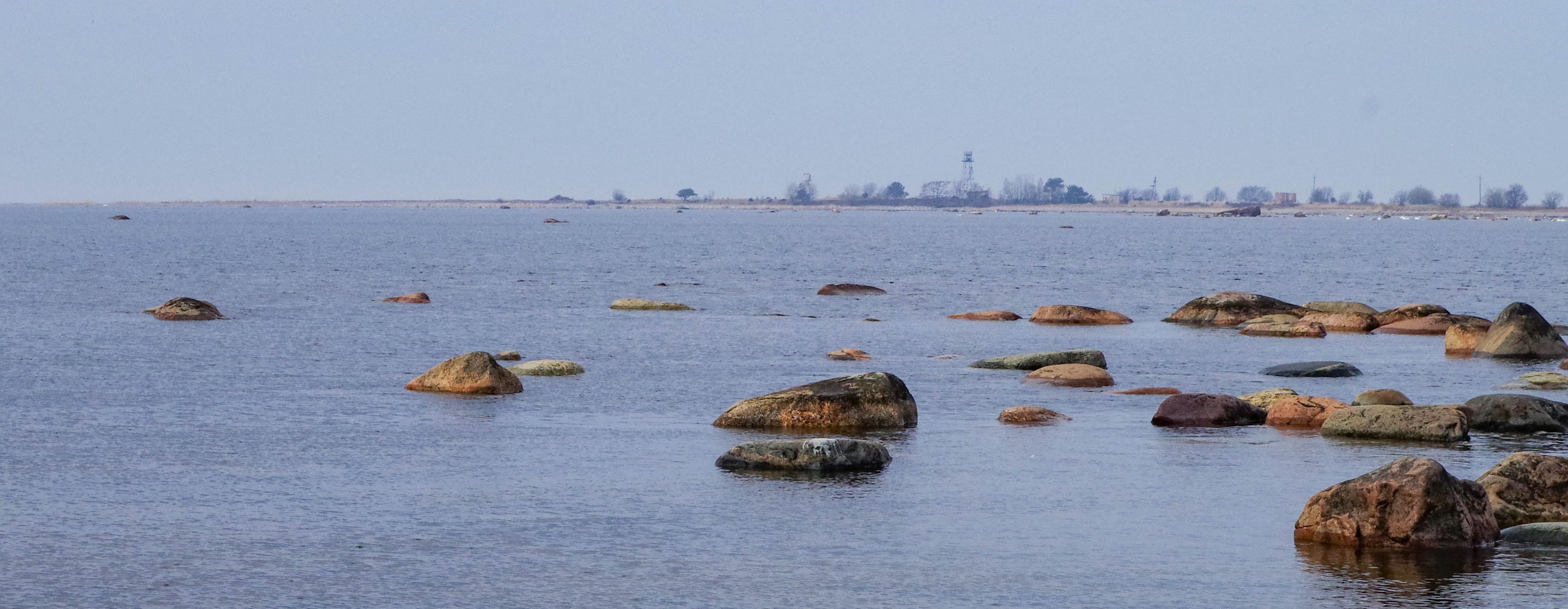Brown Rocks on Body of Water