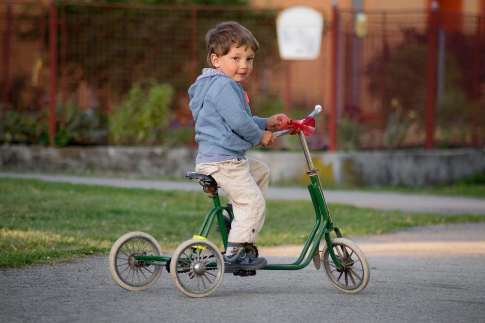 Little boy riding a bike.   Photo: Pexels