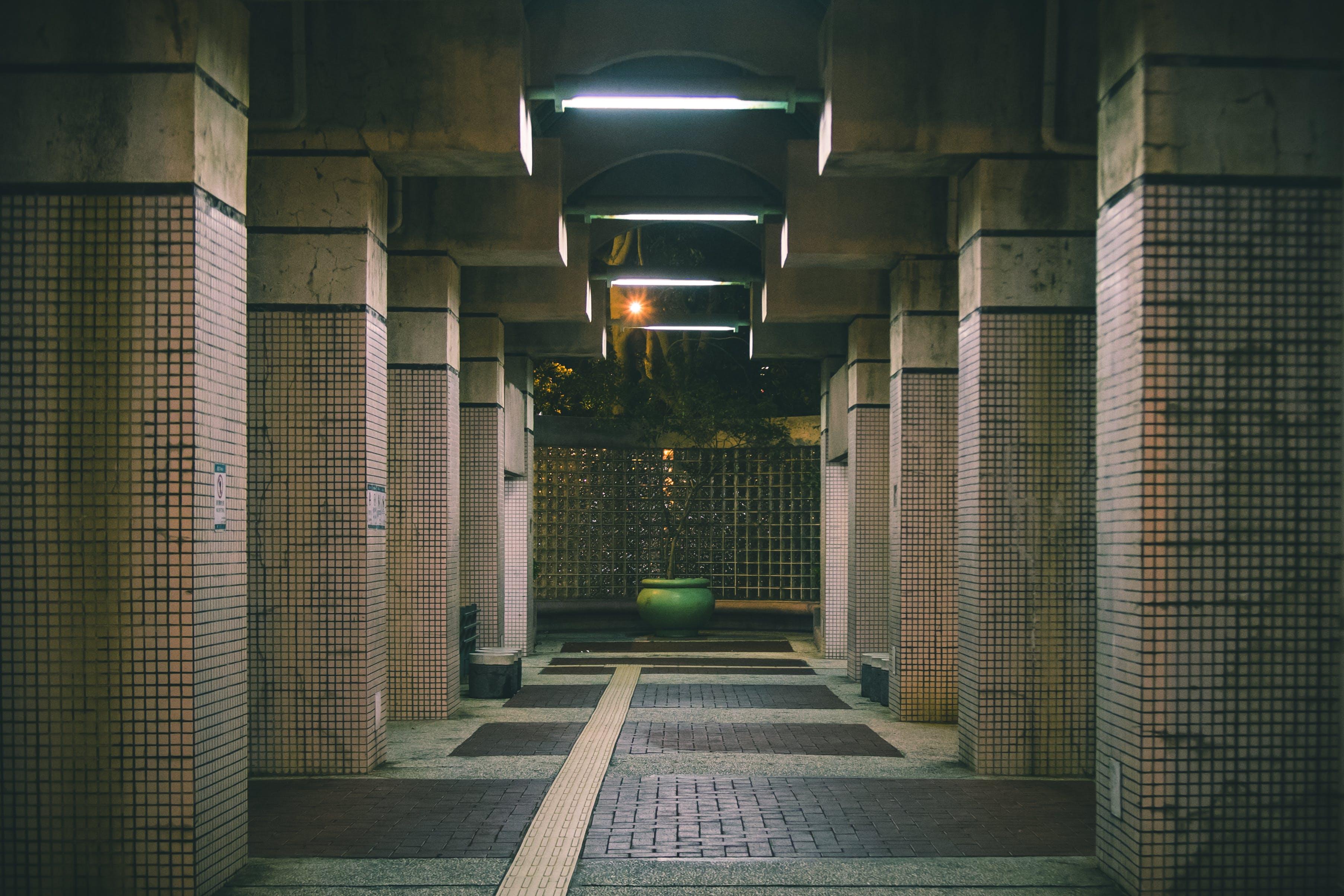 Photo of Brown Concrete Hallway