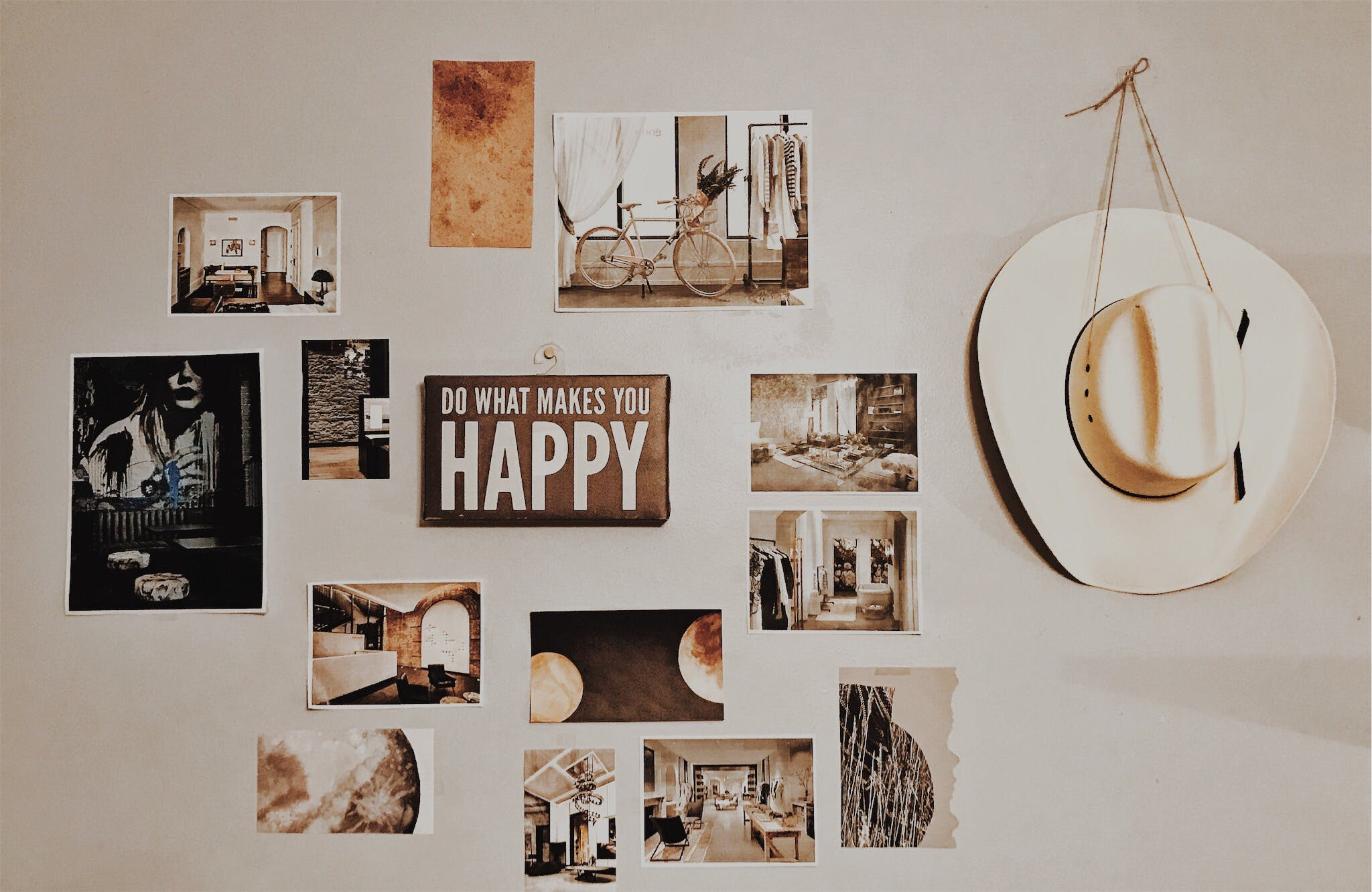 Photo of Brown and White Photo Frames Hang in Wall