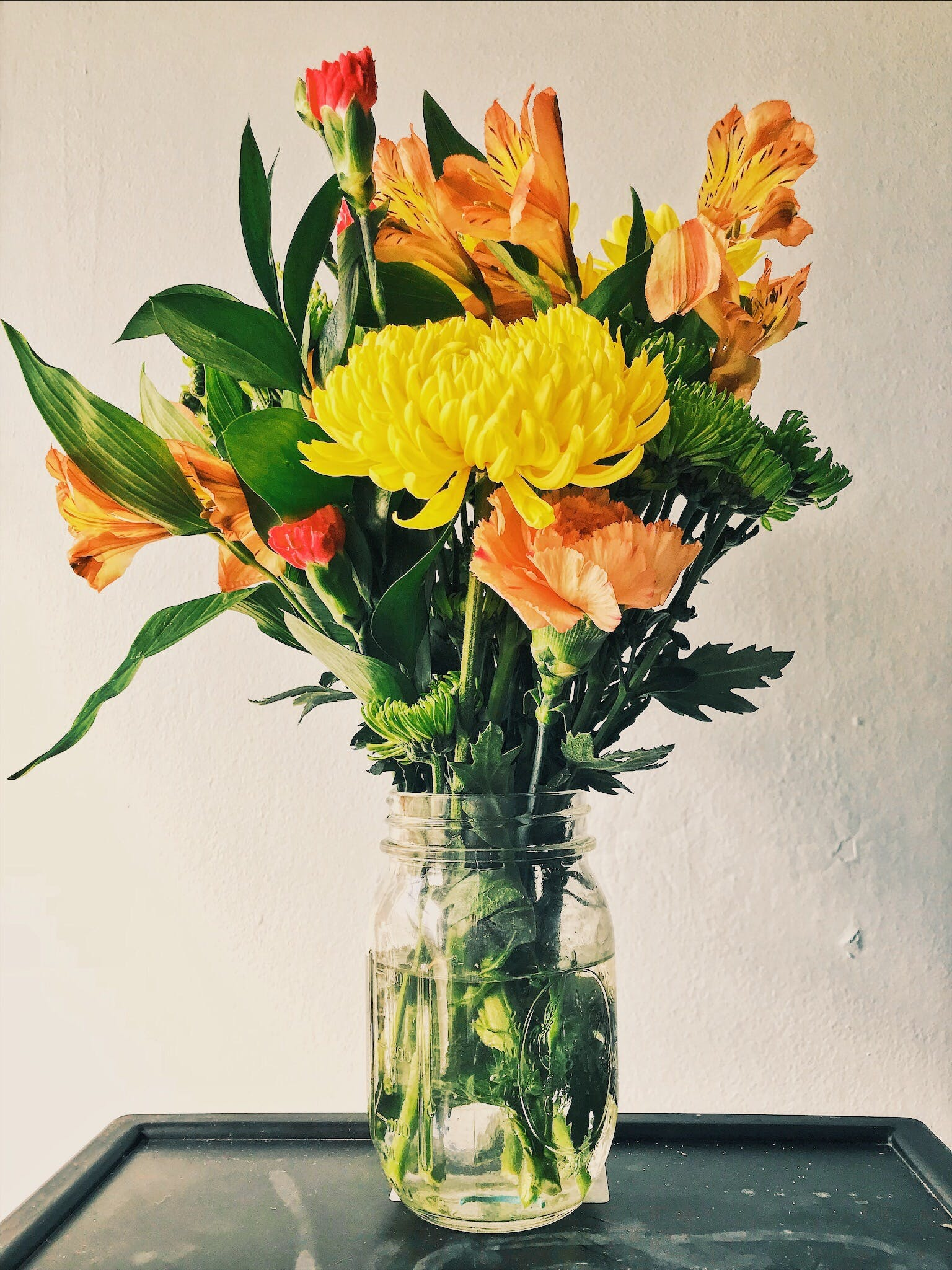 Yellow Mums, Orange Peruvian Lilies, and Carnation Flower Arrangement