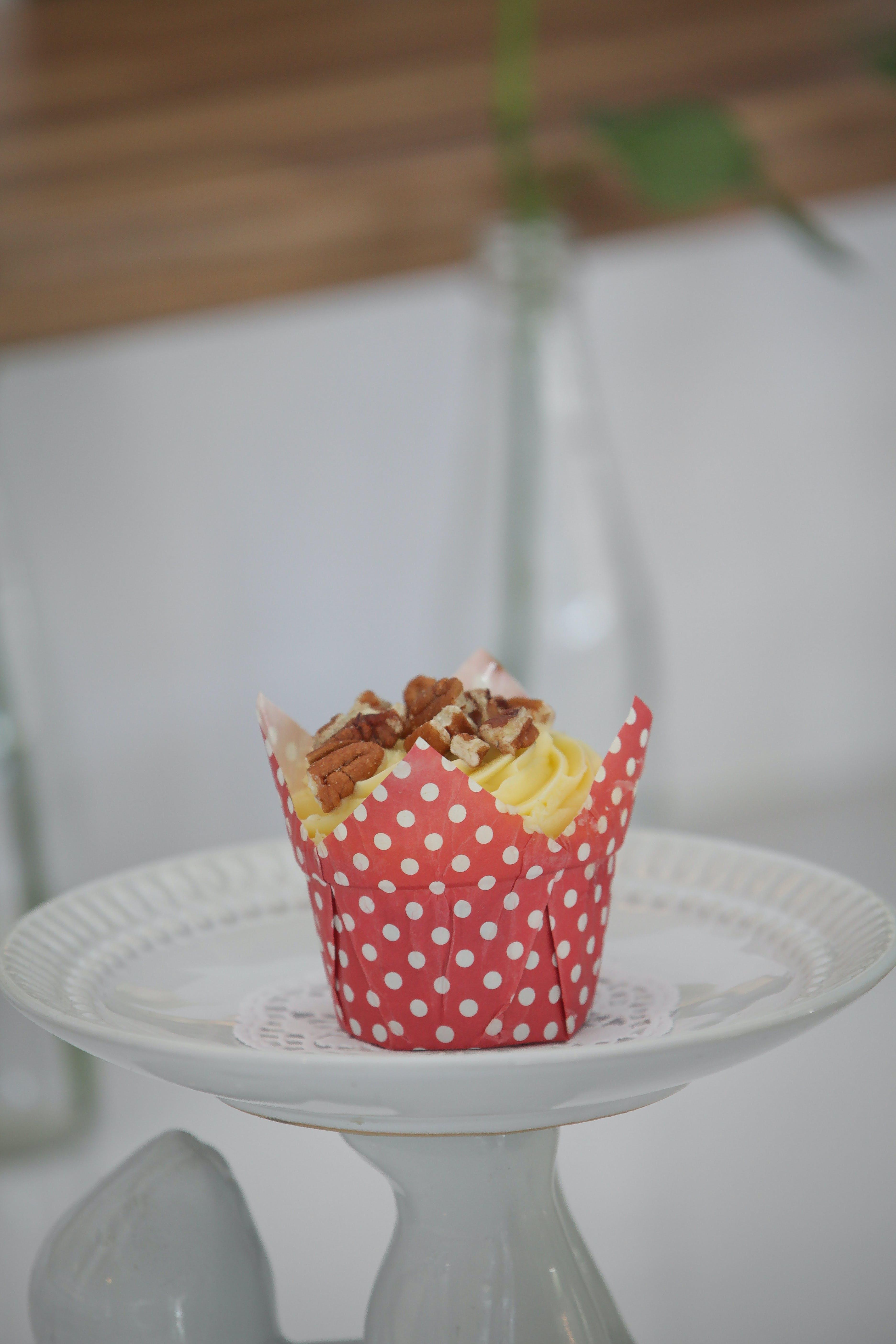 Yellow and Brown Cupcake on White Round Ceramic Plate