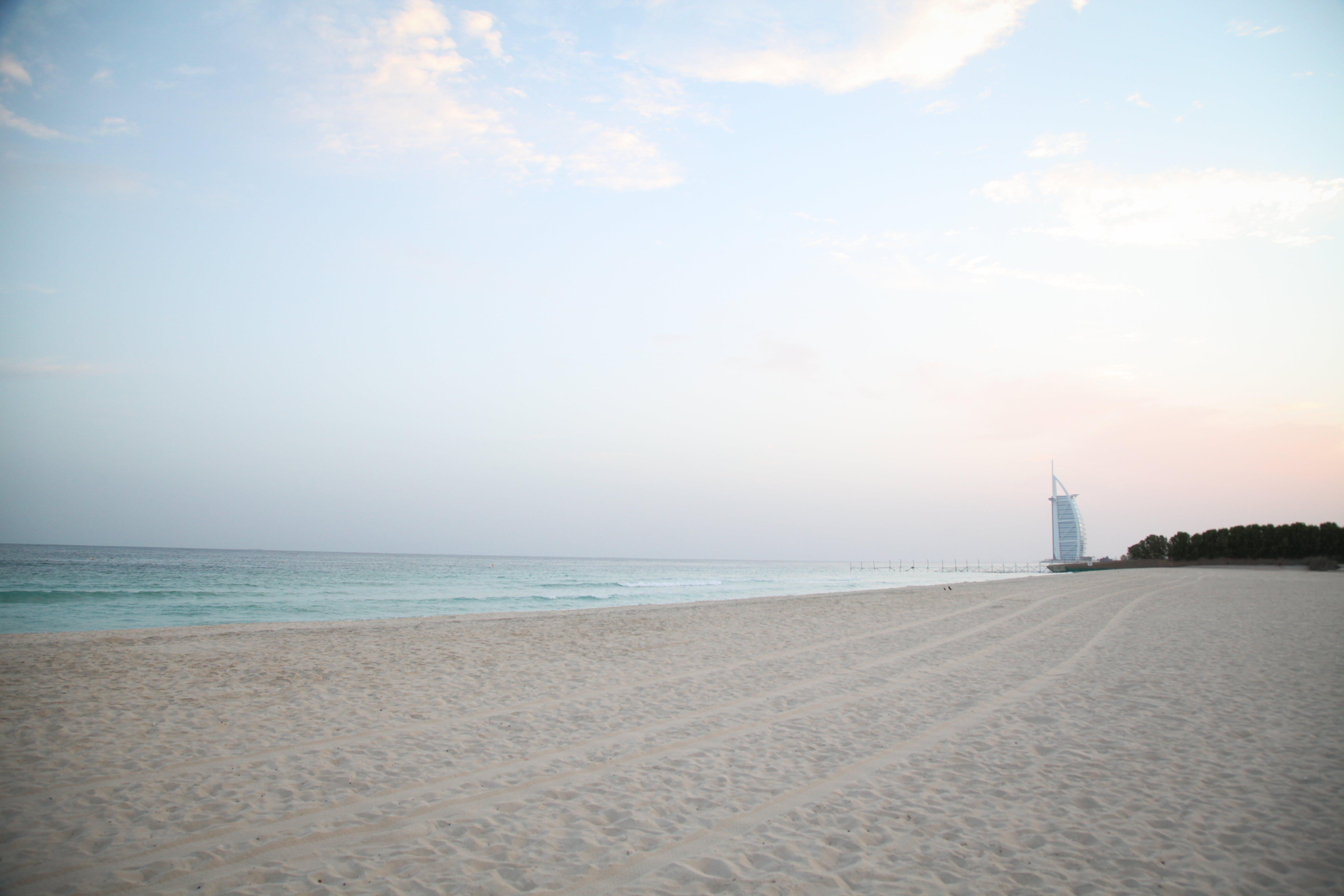 Kostenloses Stock Foto zu burj, dubai, sonnenaufgang, strand