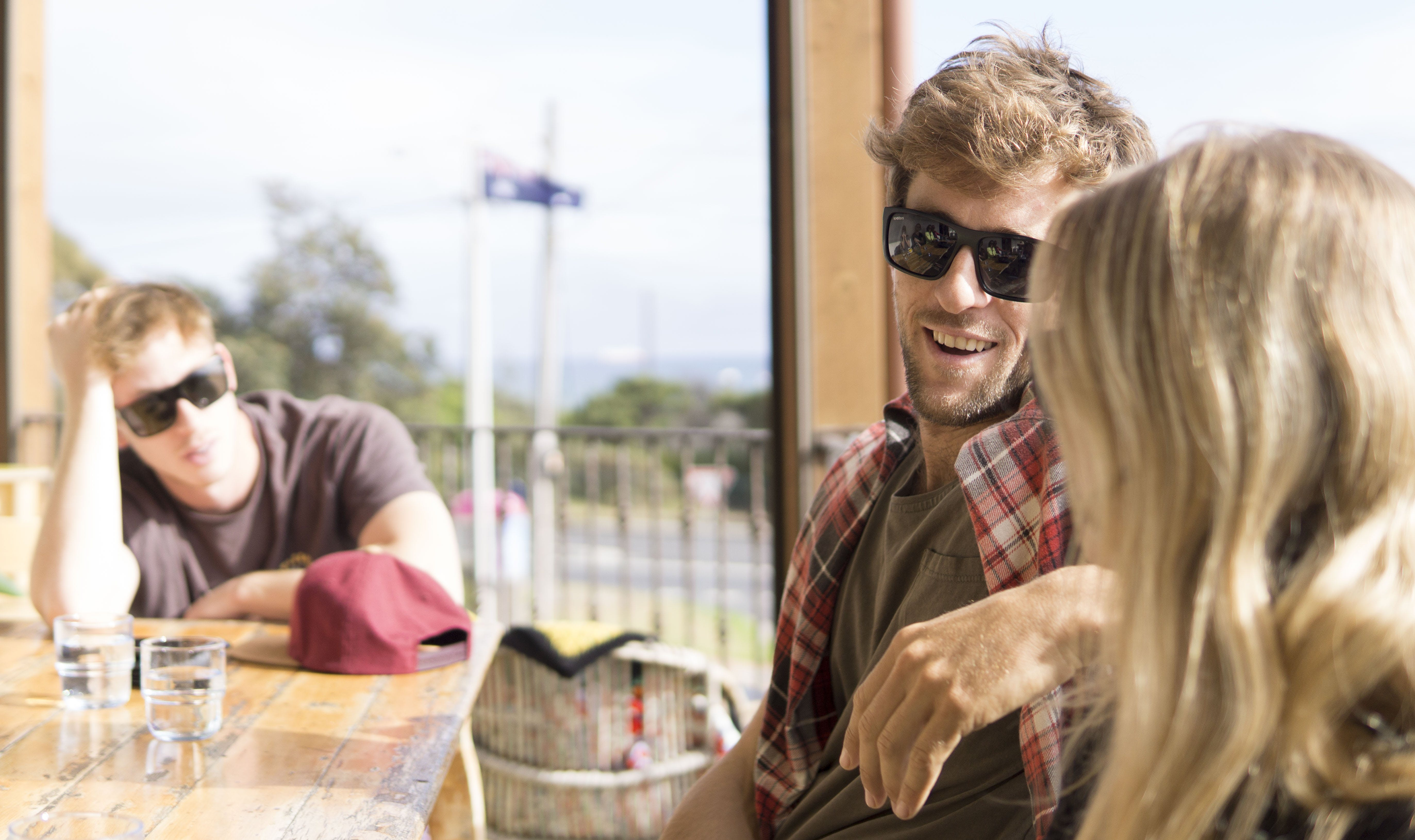 Man Sitting Beside Woman in Front of Table