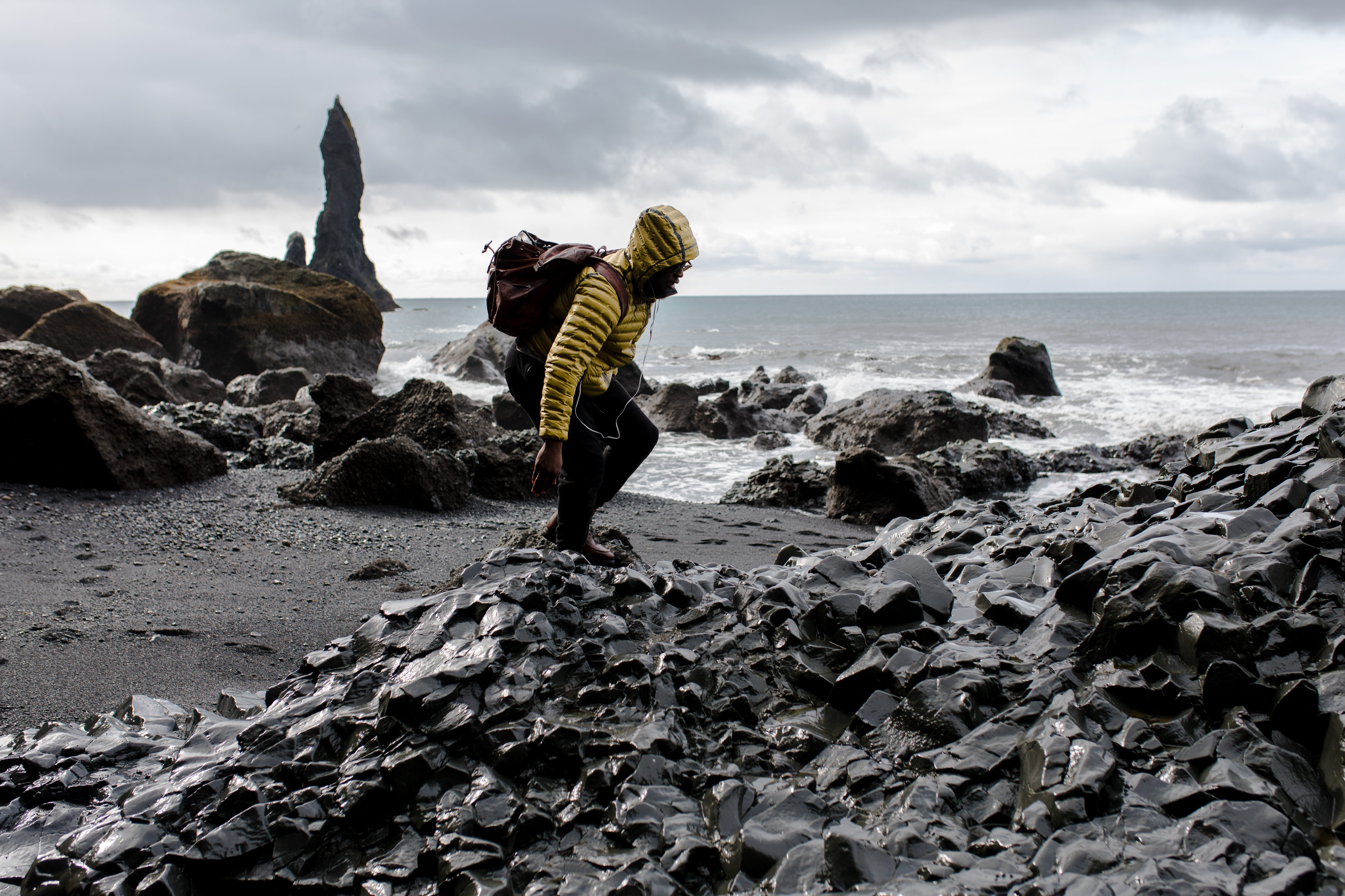 Photo of Man in Yellow Hoodie Near Seashore