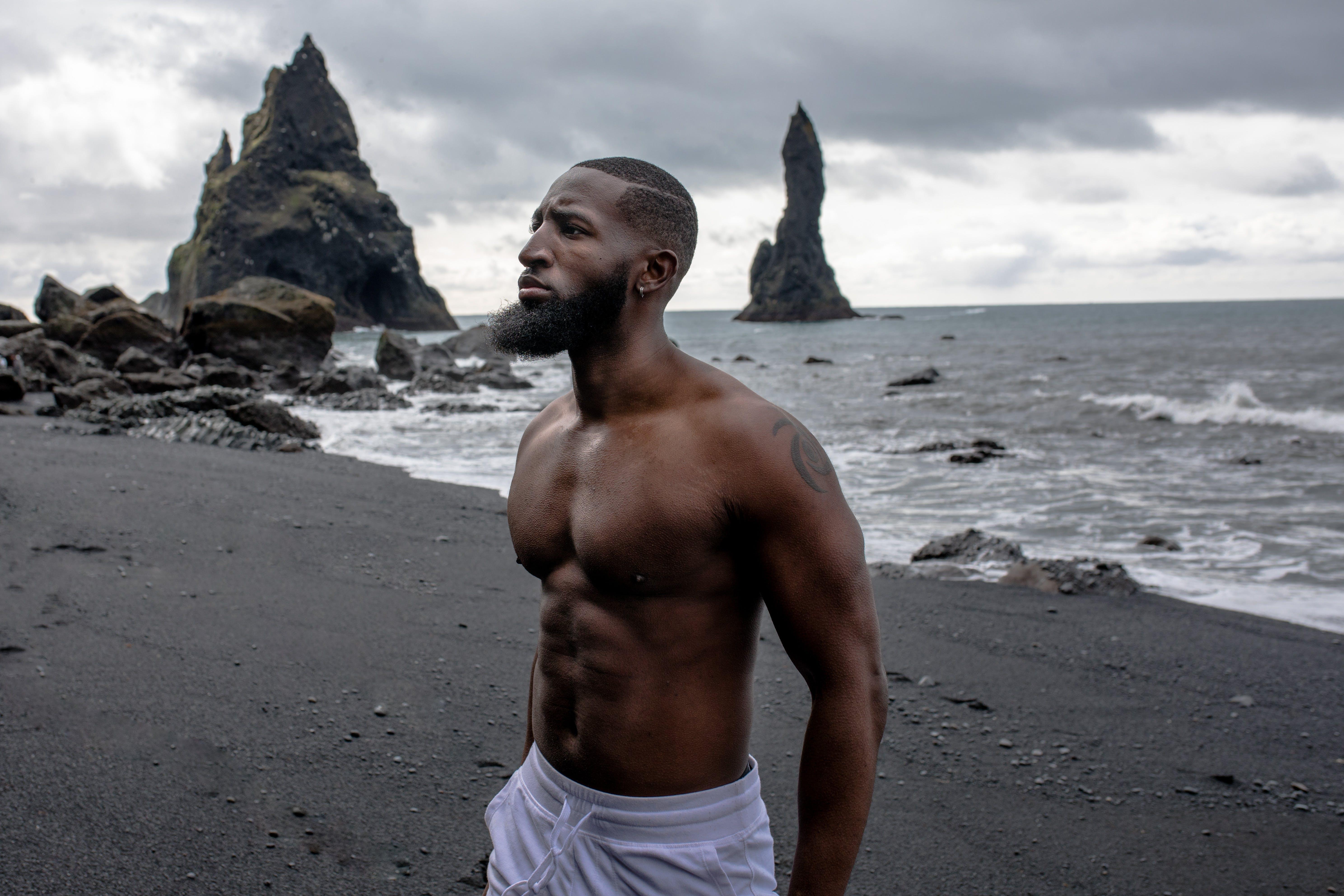 Man Wearing White Bottoms Near Body of Water