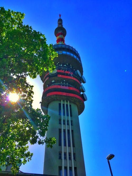 Foto stok gratis Hongaria, langit biru, matahari, menara