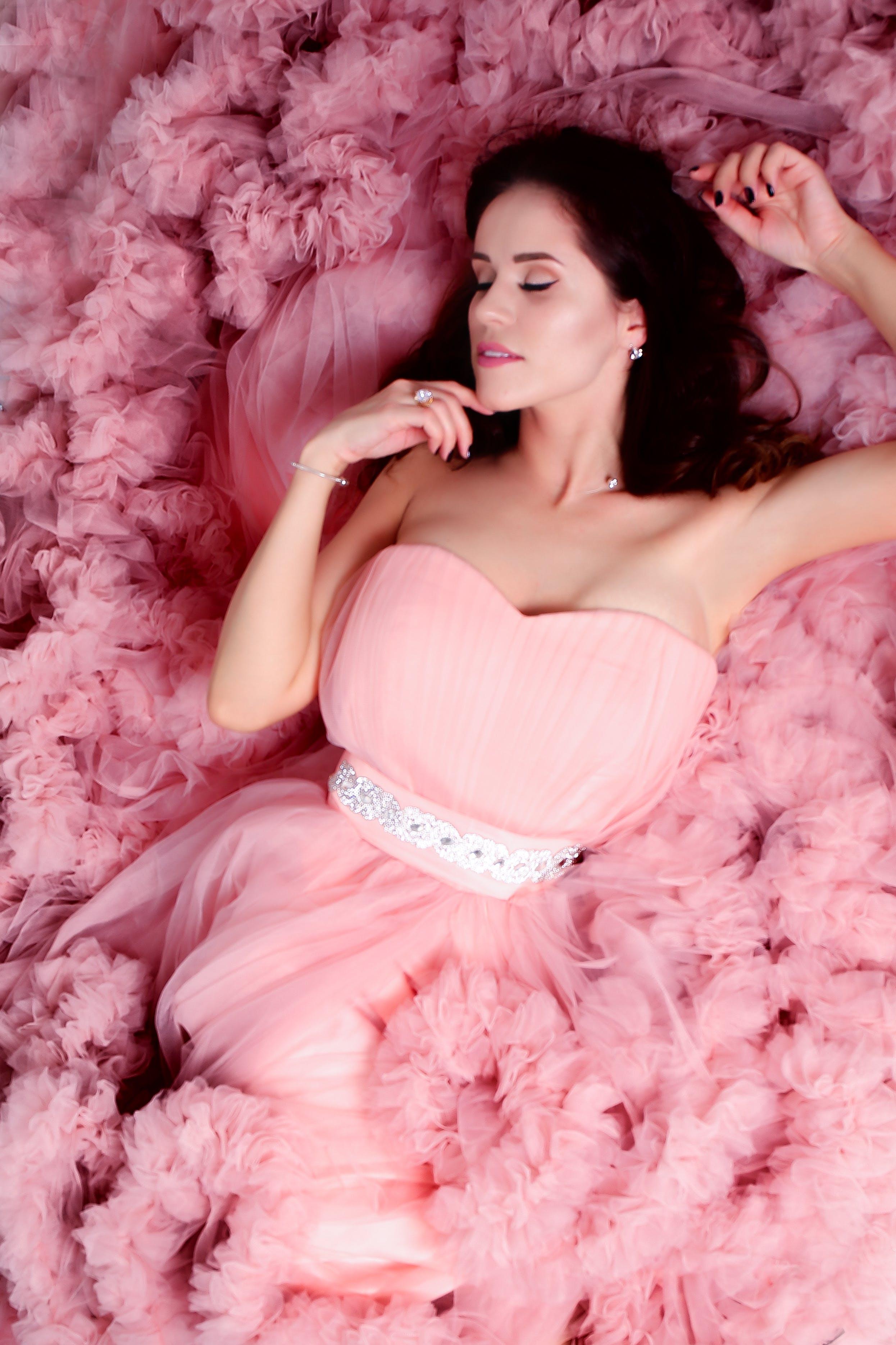 Lying Woman Wearing Pink Sweetheart Neckline Dress