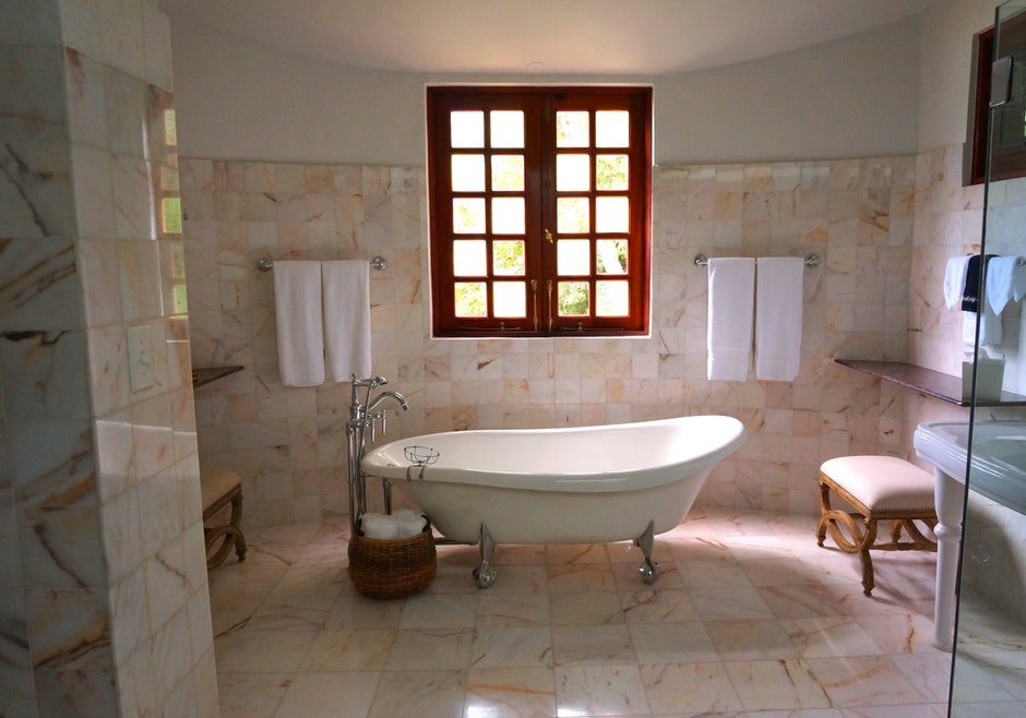 White Bathtub on White Tile Bathroom Near Brown Framed Clear Glass Window
