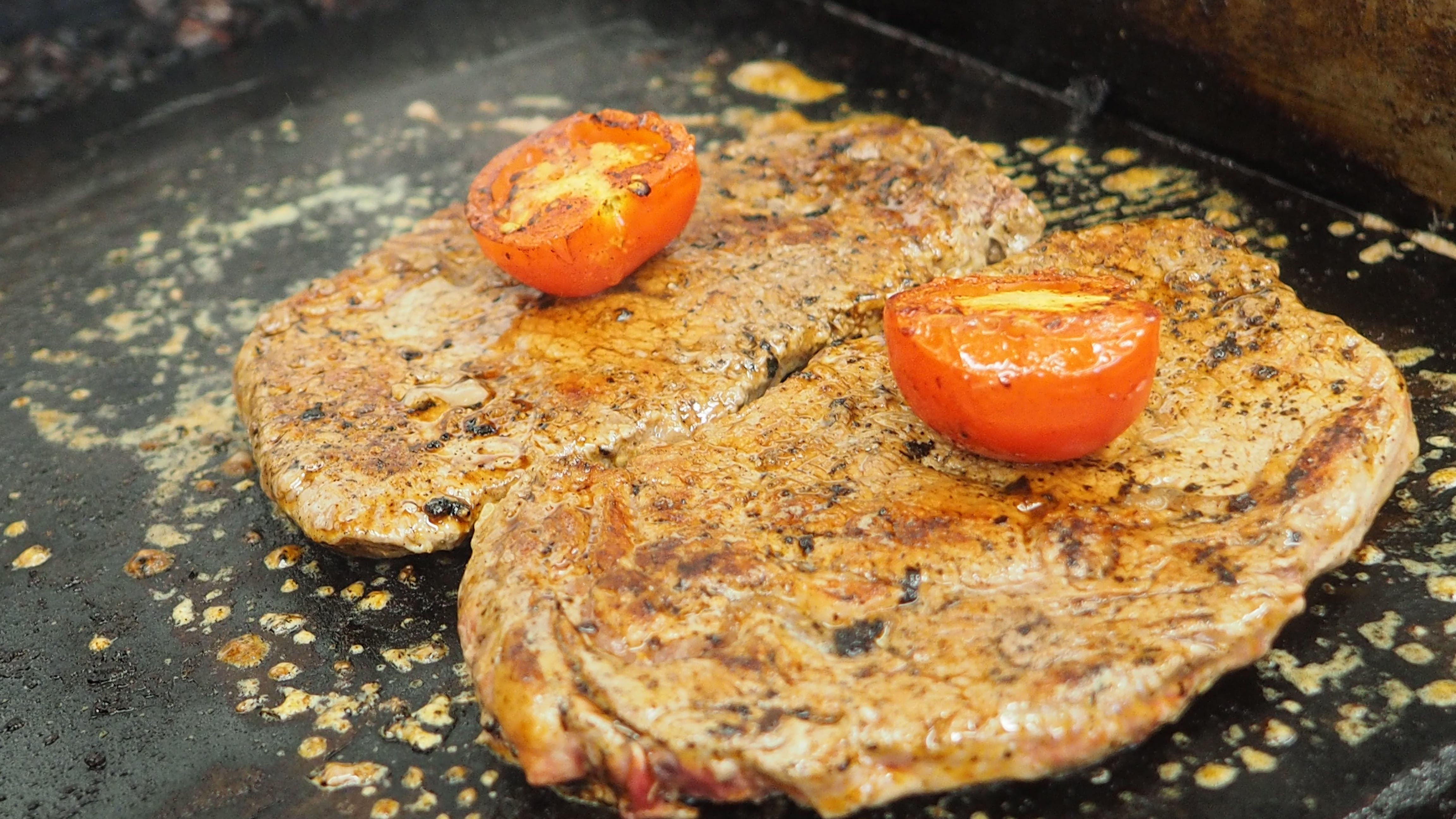 Free stock photo of cooking steak, steak, steak and tomato, steak being cooked