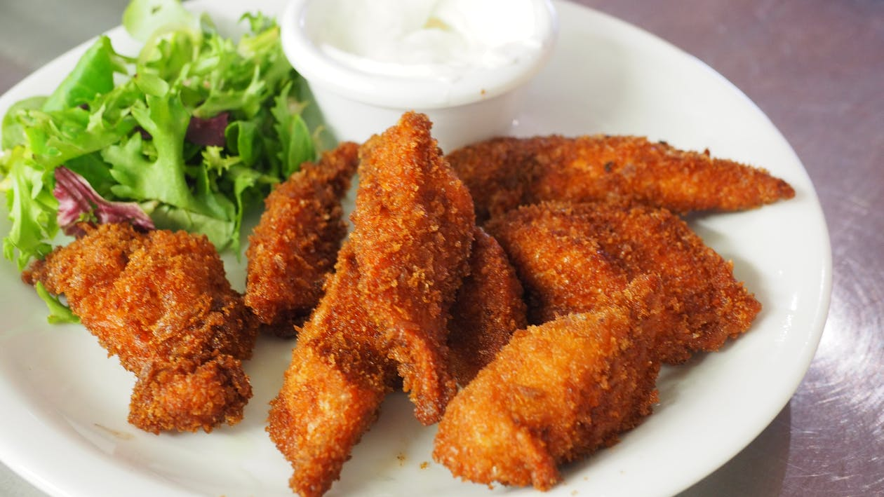 Fried Meat on Top of White Plate