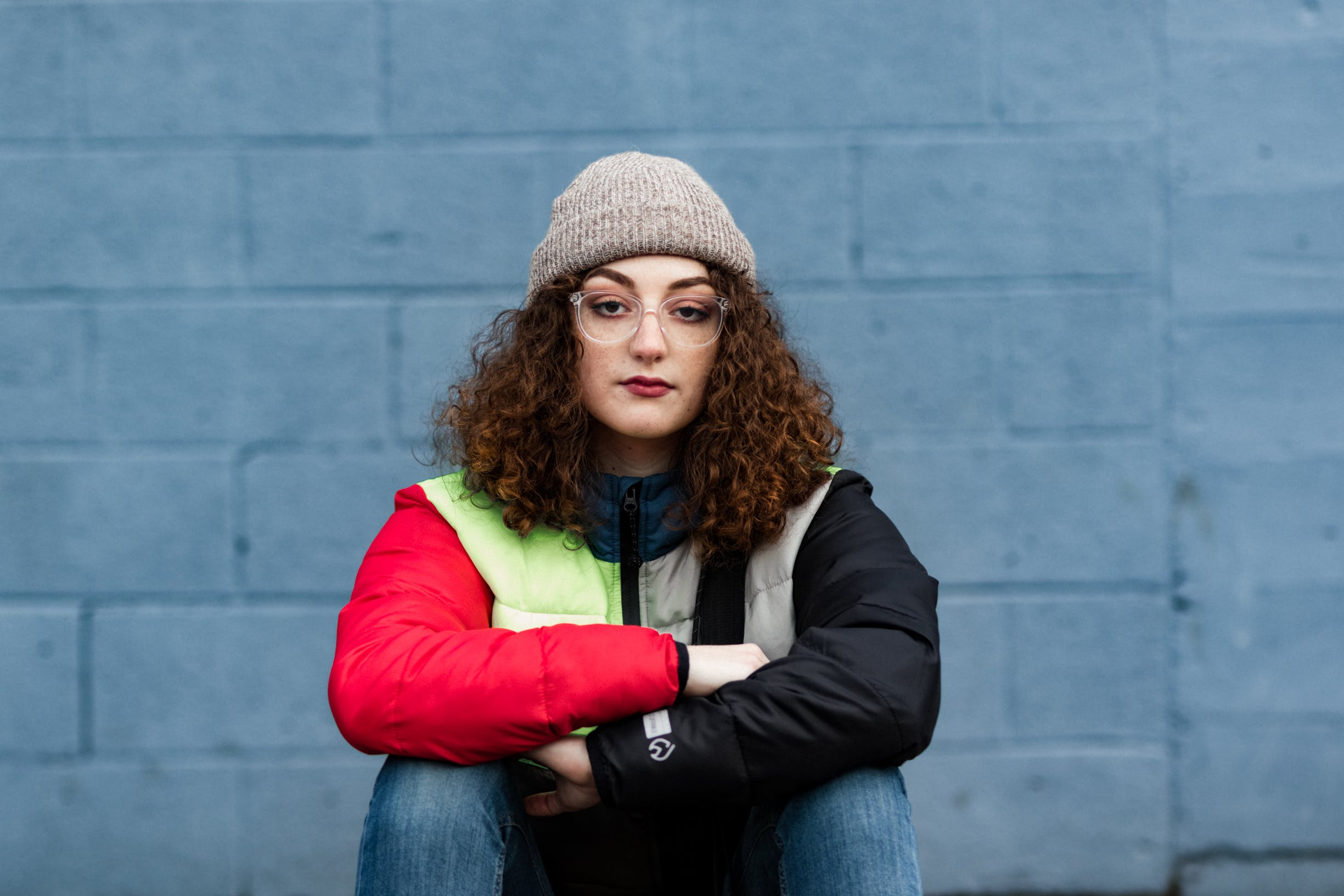 Woman Wearing Red and Black Zip-up Jacket