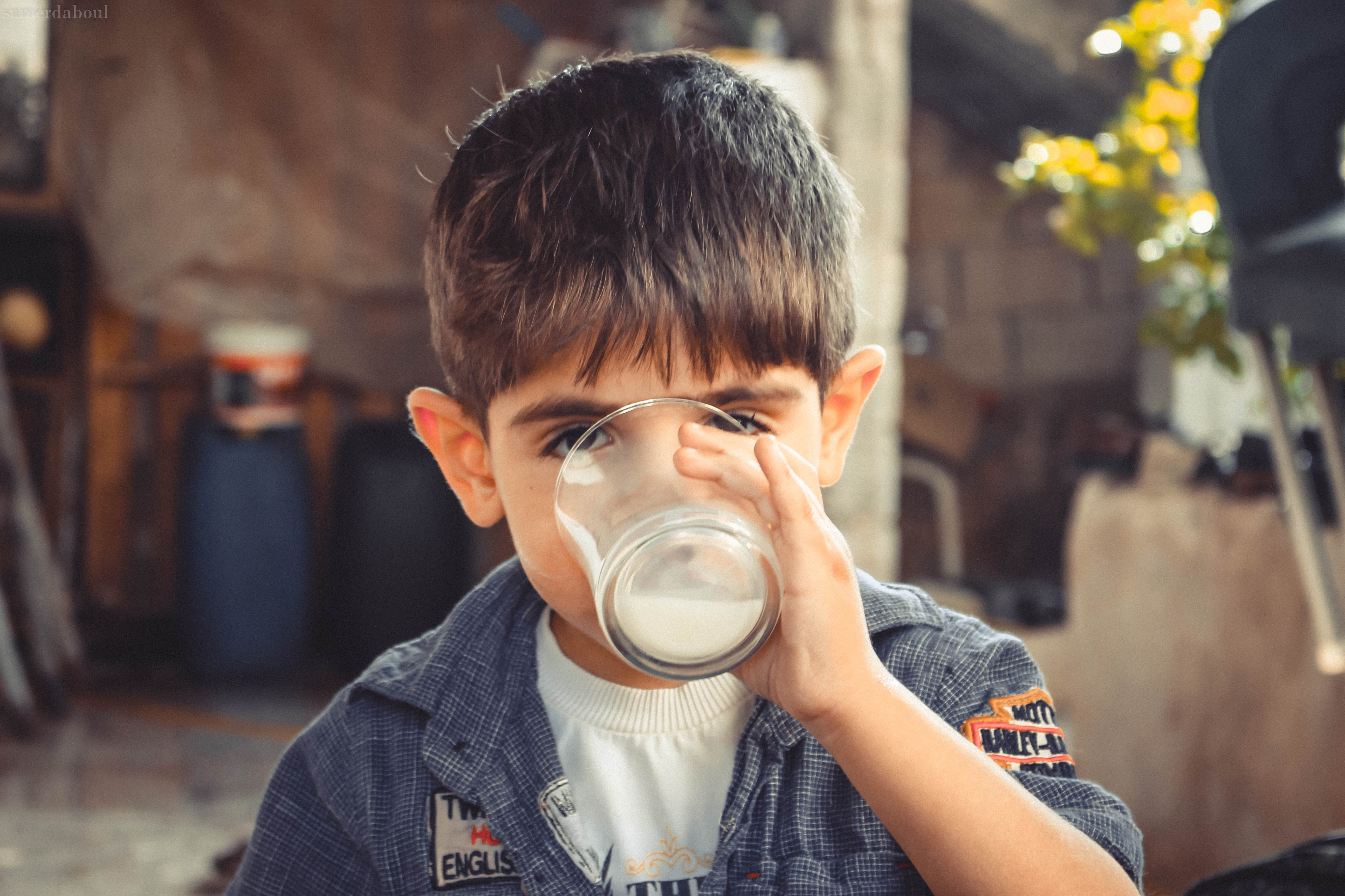 Boy Holding Clear Drinking Glass