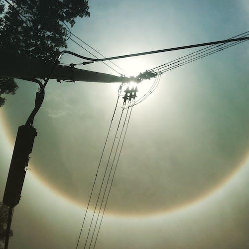Free stock photo of circular rainbow, electric post, rainbow
