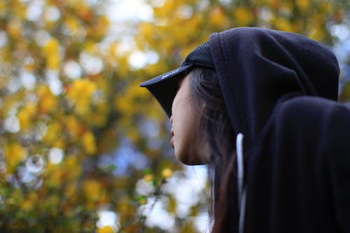 Close-Up Photography of a Woman Wearing Hoodie