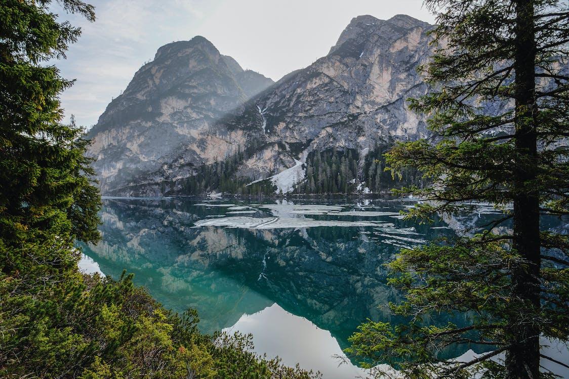 Mountains Near Body of Water Panoramic Photo